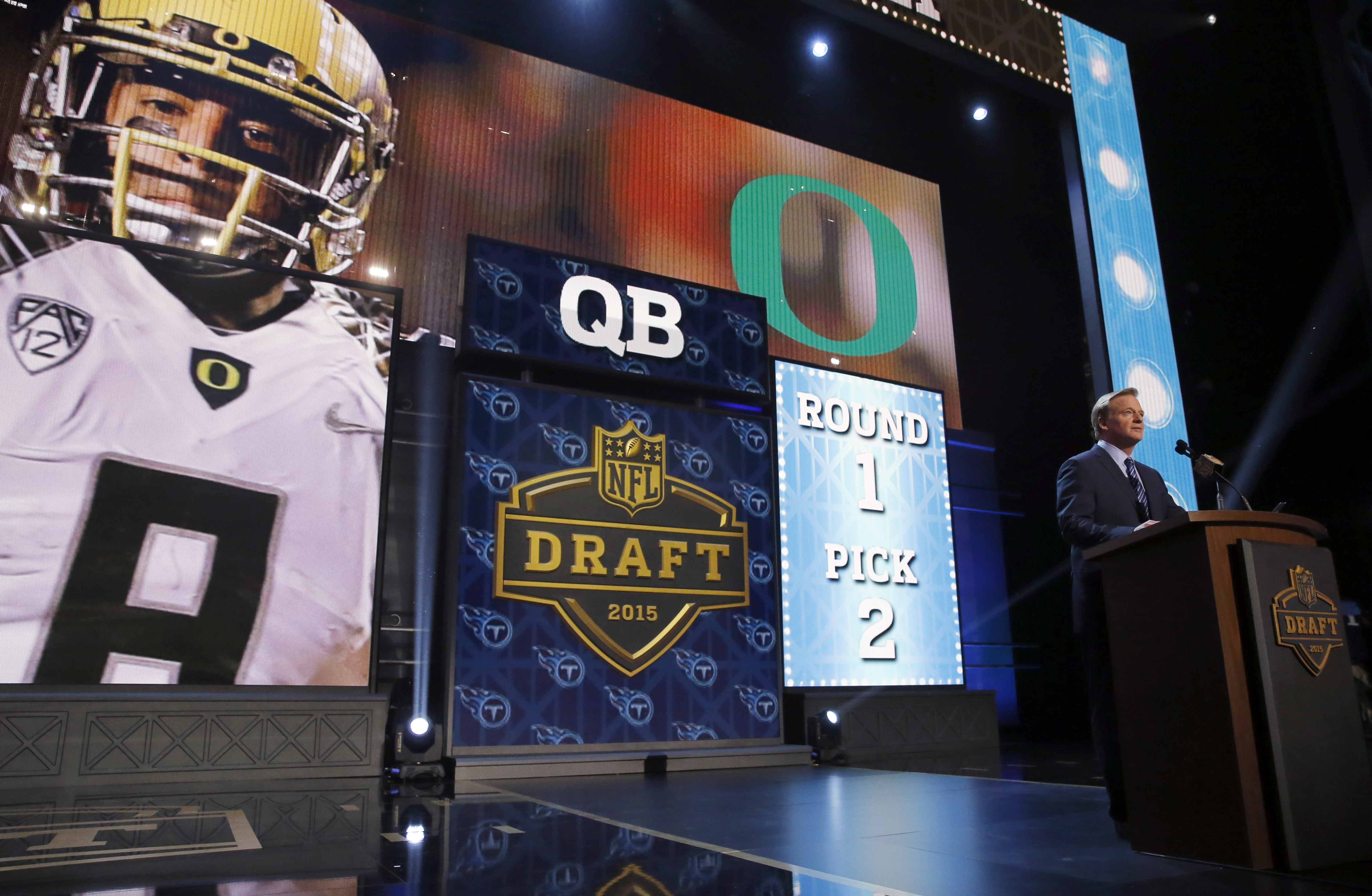 NFL commissioner Roger Goodell announces after the Tennessee Titans  selected Oregon quarterback Marcus Mariota as the second pick in the first round of the 2015 NFL Draft,  Thursday, April 30, 2015, in Chicago. (AP Photo/Charles Rex Arbogast)
