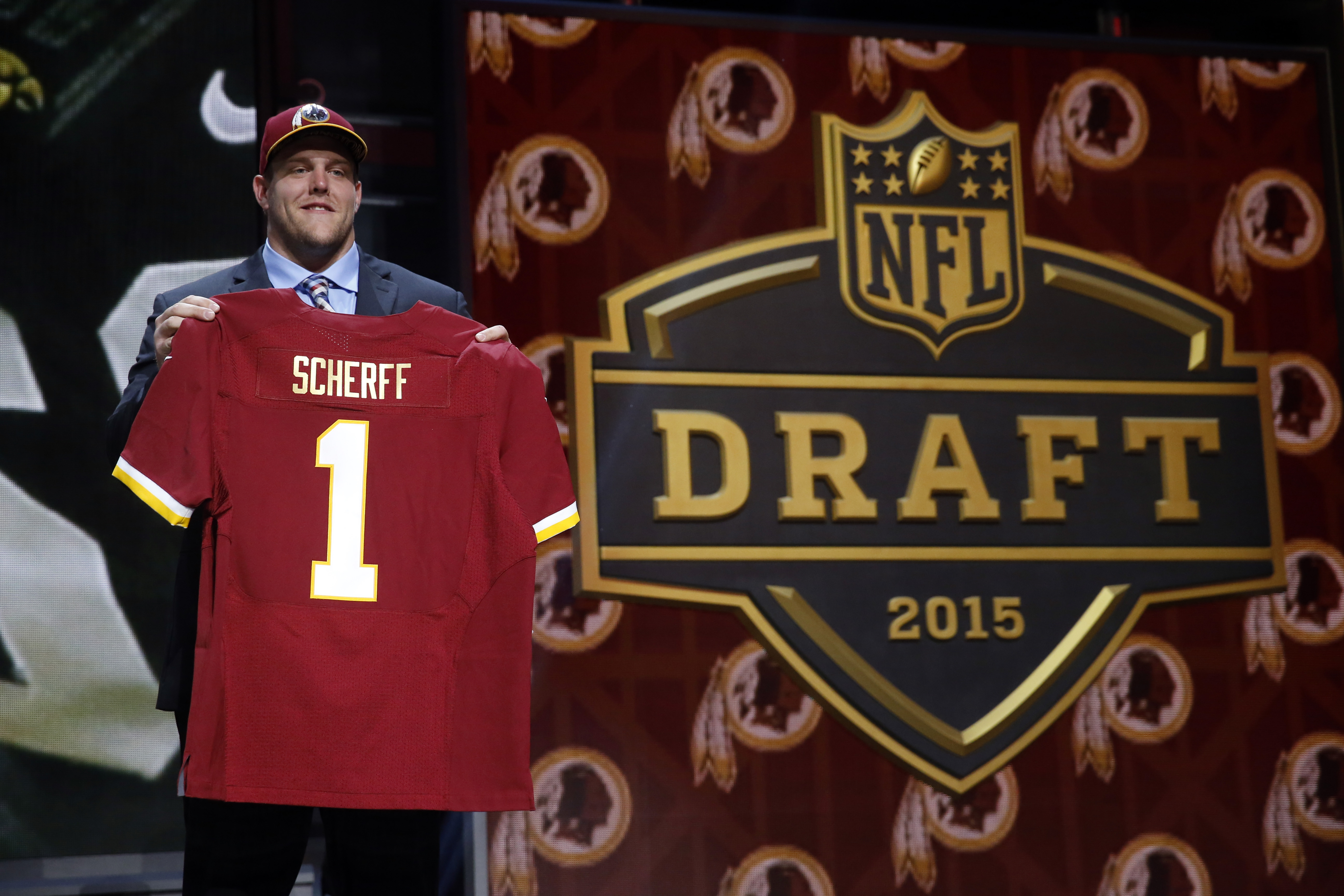 Iowa offensive lineman Brandon Scherff poses for photos after being selected by the Washington Redskins as the fifth pick in the first round of the 2015 NFL Draft,  Thursday, April 30, 2015, in Chicago. (AP Photo/Charles Rex Arbogast)