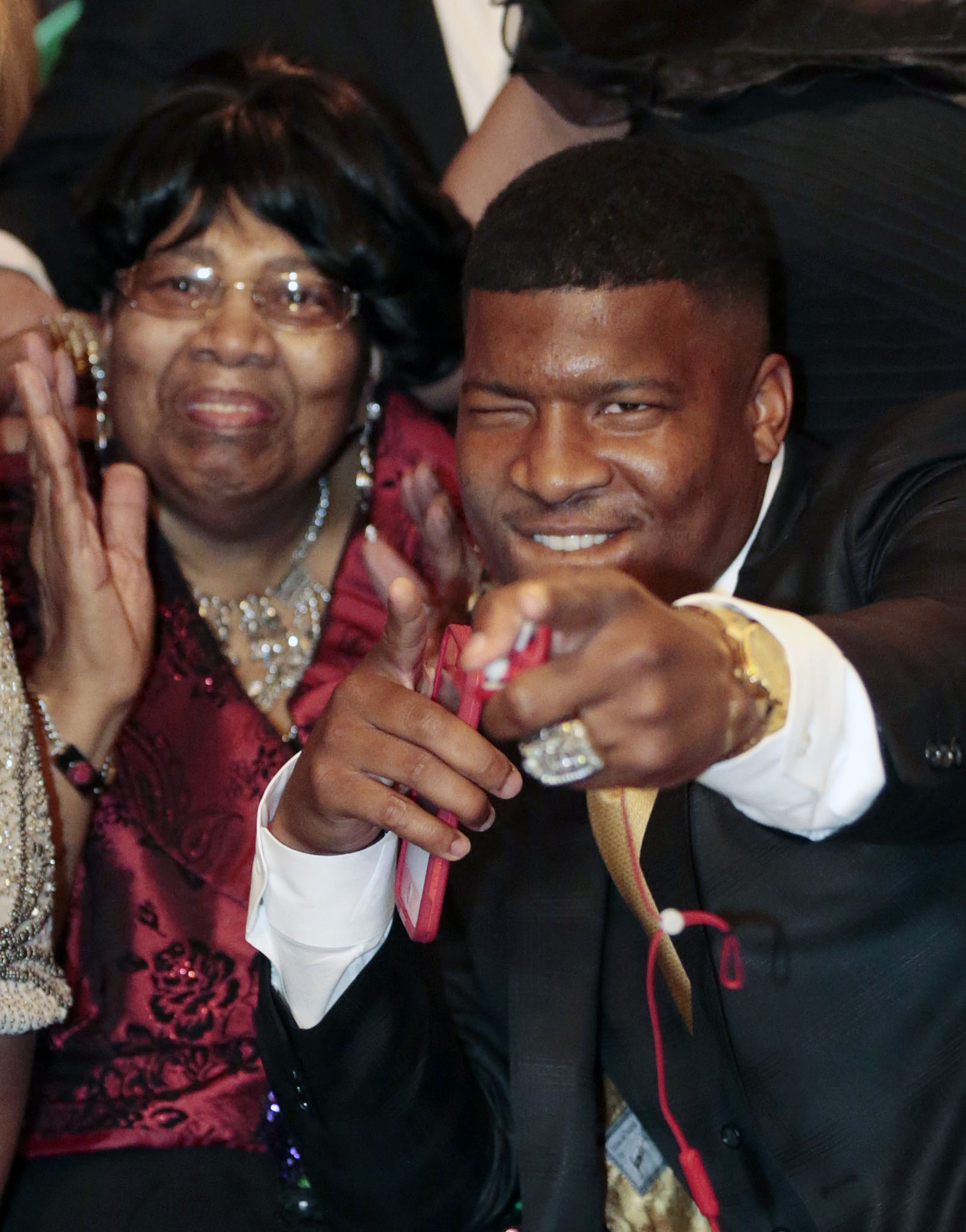 Jameis Winston reacts to the announcement with his Grandmother, Myrtle Winston, watching as the Tampa Bay Buccaneers select him as the number one draft pick in the 2015 NFL Draft, Thursday, April 30, 2015, in Bessemer, Ala. (AP Photo/Butch Dill)