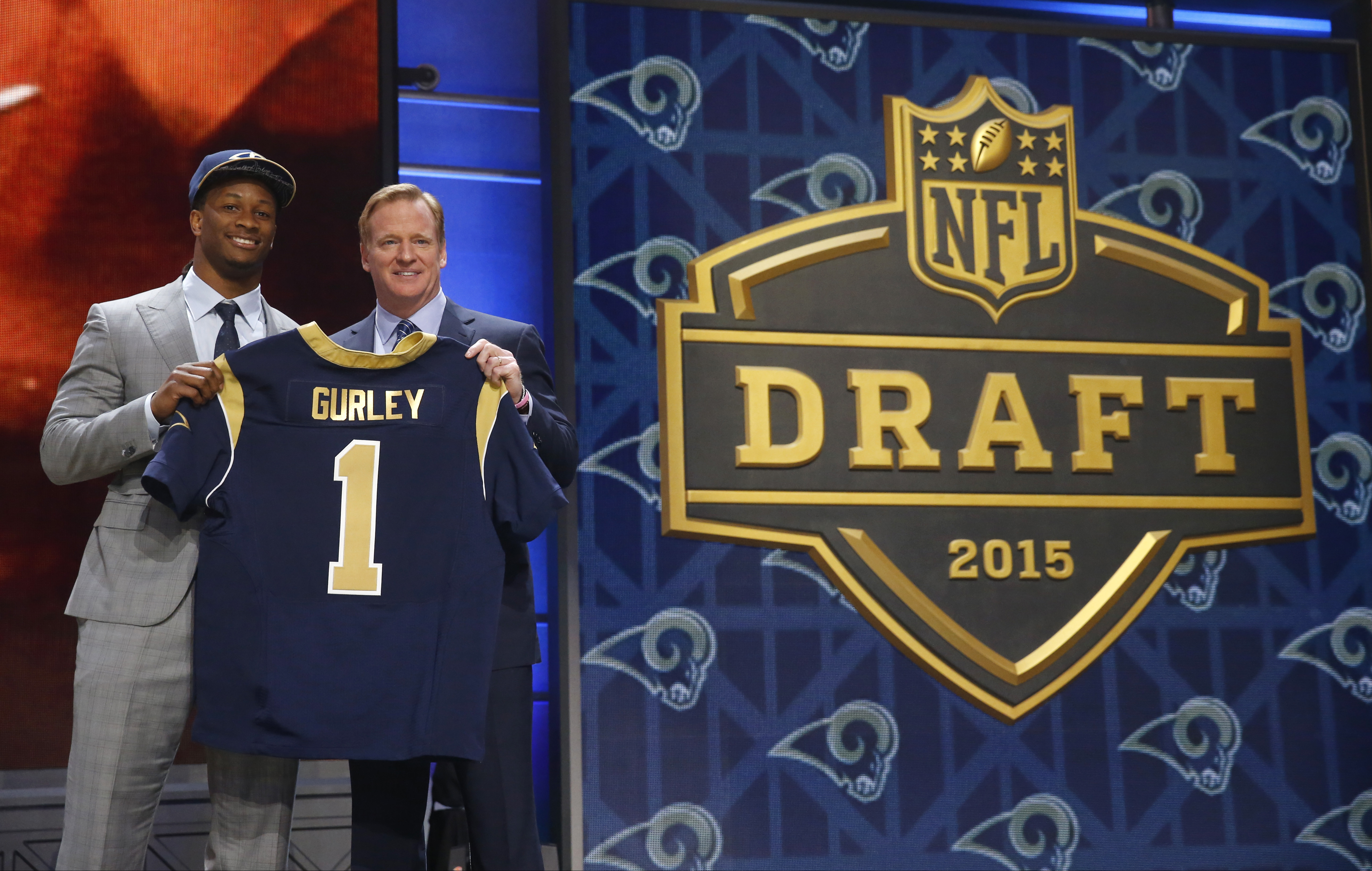 Georgia running back Todd Gurley poses for photos with NFL commissioner Roger Goodell after being selected by the St. Louis Rams as the 10th pick in the first round of the 2015 NFL Draft,  Thursday, April 30, 2015, in Chicago. (AP Photo/Charles Rex Arboga