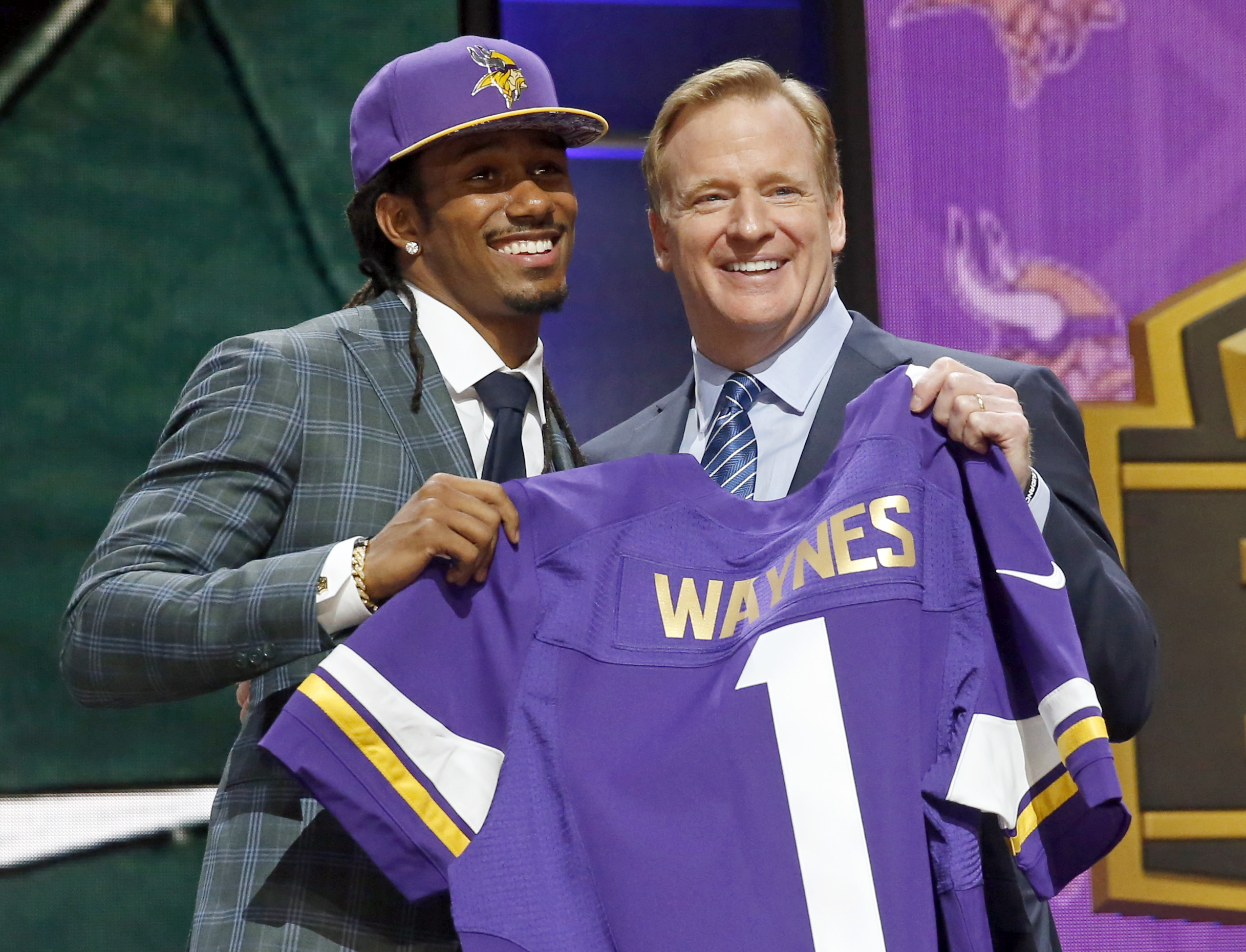 Michigan State defensive back Trae Waynes poses for photos with NFL commissioner Roger Goodell after being selected by the Minnesota Vikings as the 11th pick in the first round of the 2015 NFL Draft,  Thursday, April 30, 2015, in Chicago. (AP Photo/Charle