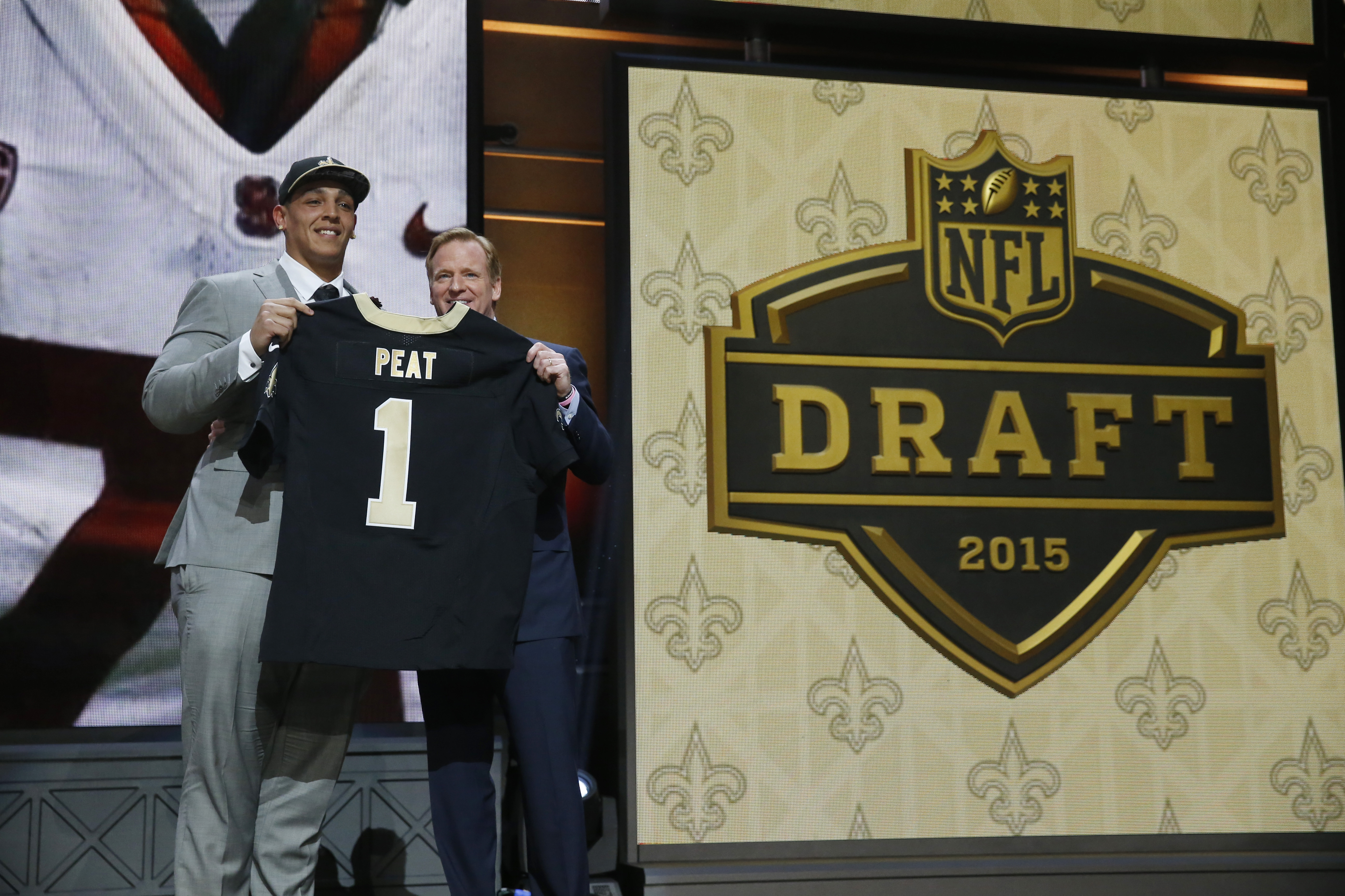 Stanford offensive lineman Andrus Peat poses for photos with NFL commissioner Roger Goodell after being selected by the New Orleans Saints as the 13th pick in the first round of the 2015 NFL Draft,  Thursday, April 30, 2015, in Chicago. (AP Photo/Charles
