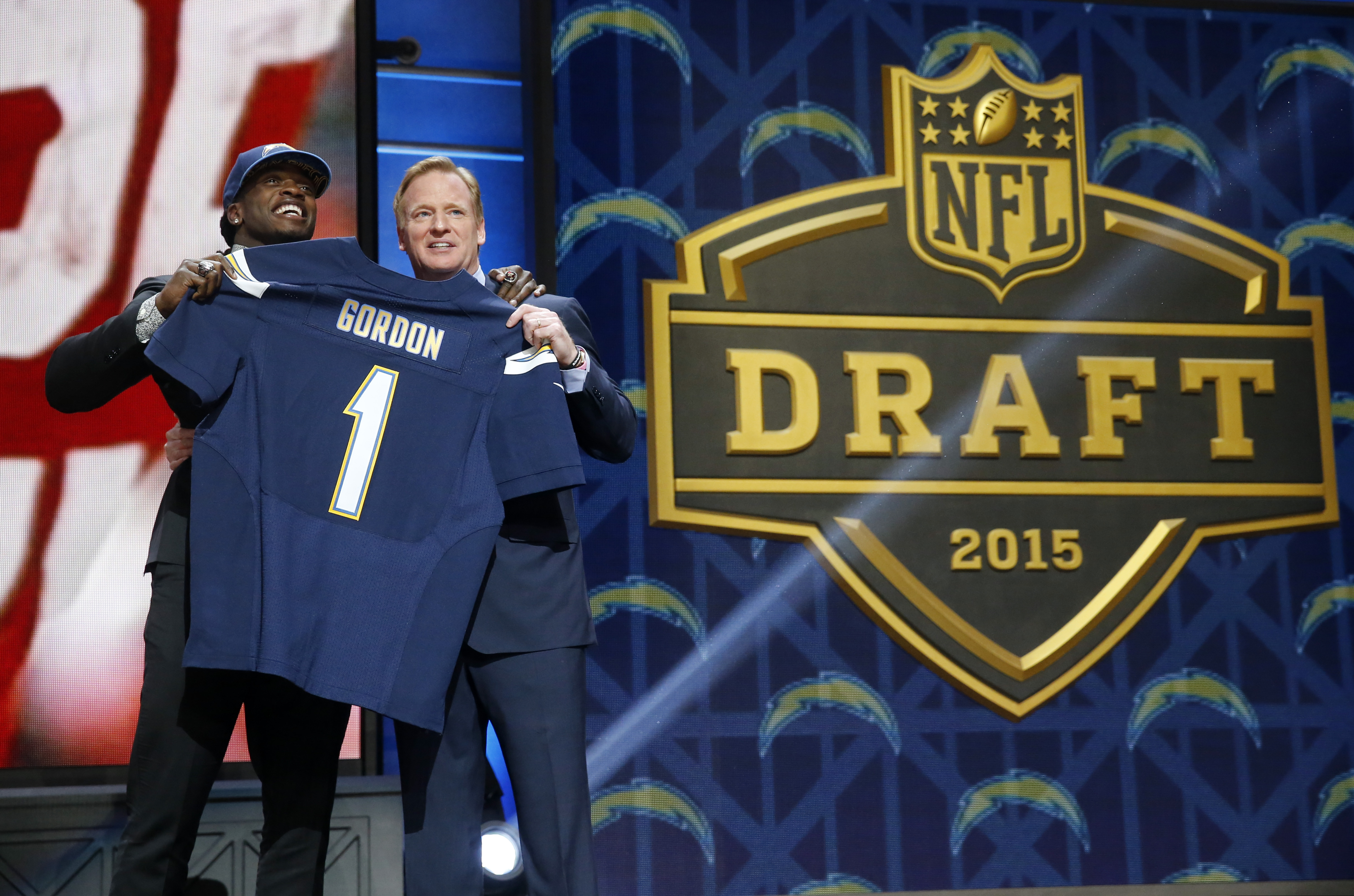 Wisconsin running back Melvin Gordon poses for photos with NFL commissioner Roger Goodell after being selected by the San Diego Chargers as the 15th pick in the first round of the 2015 NFL Draft,  Thursday, April 30, 2015, in Chicago. (AP Photo/Charles Re