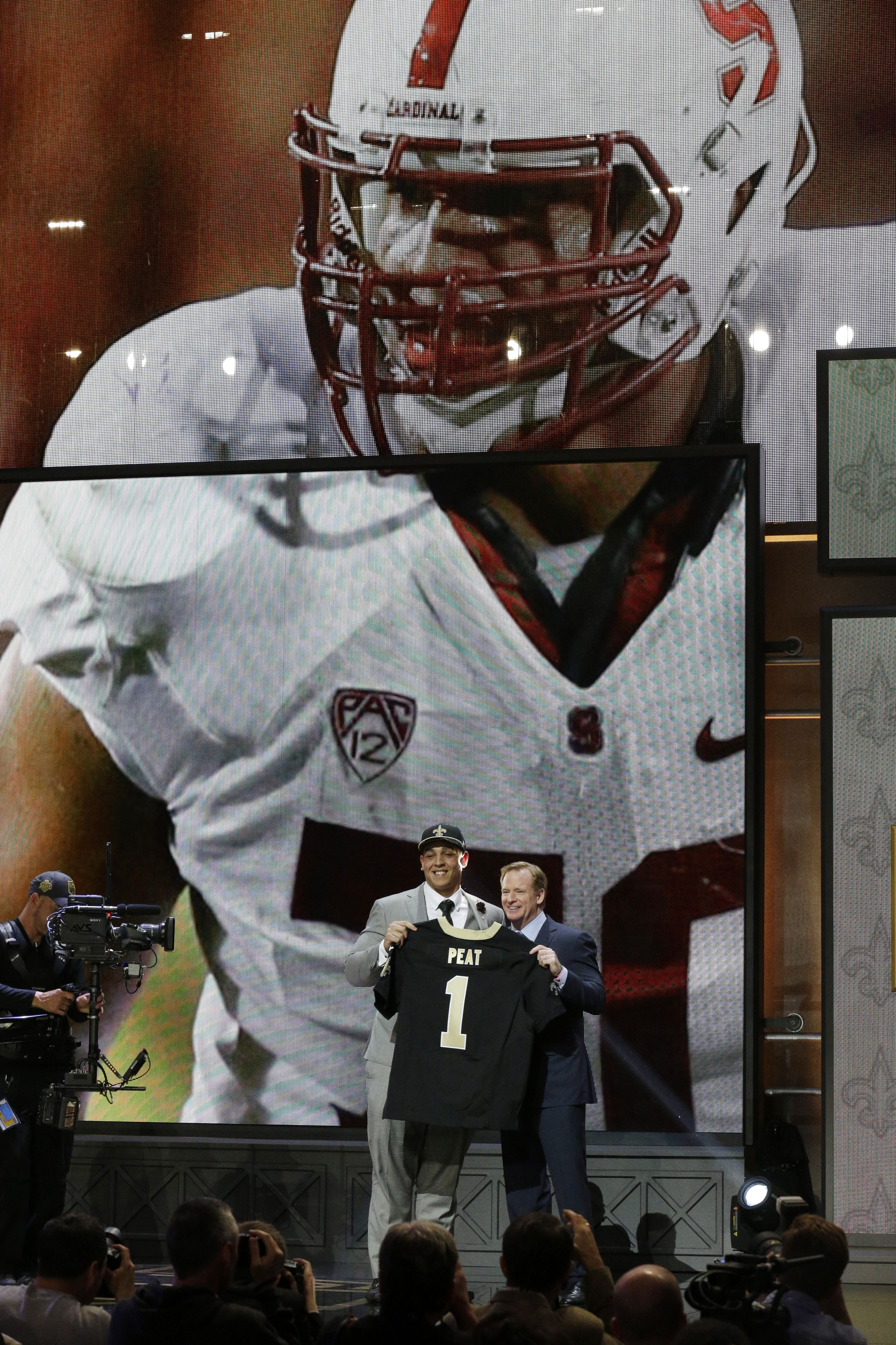 Stanford offensive lineman Andrus Peat poses for photos with NFL commissioner Roger Goodell after being selected by the New Orleans Saints as the 13th pick in the first round of the 2015 NFL Draft,  Thursday, April 30, 2015, in Chicago. (AP Photo/Nam Y. H