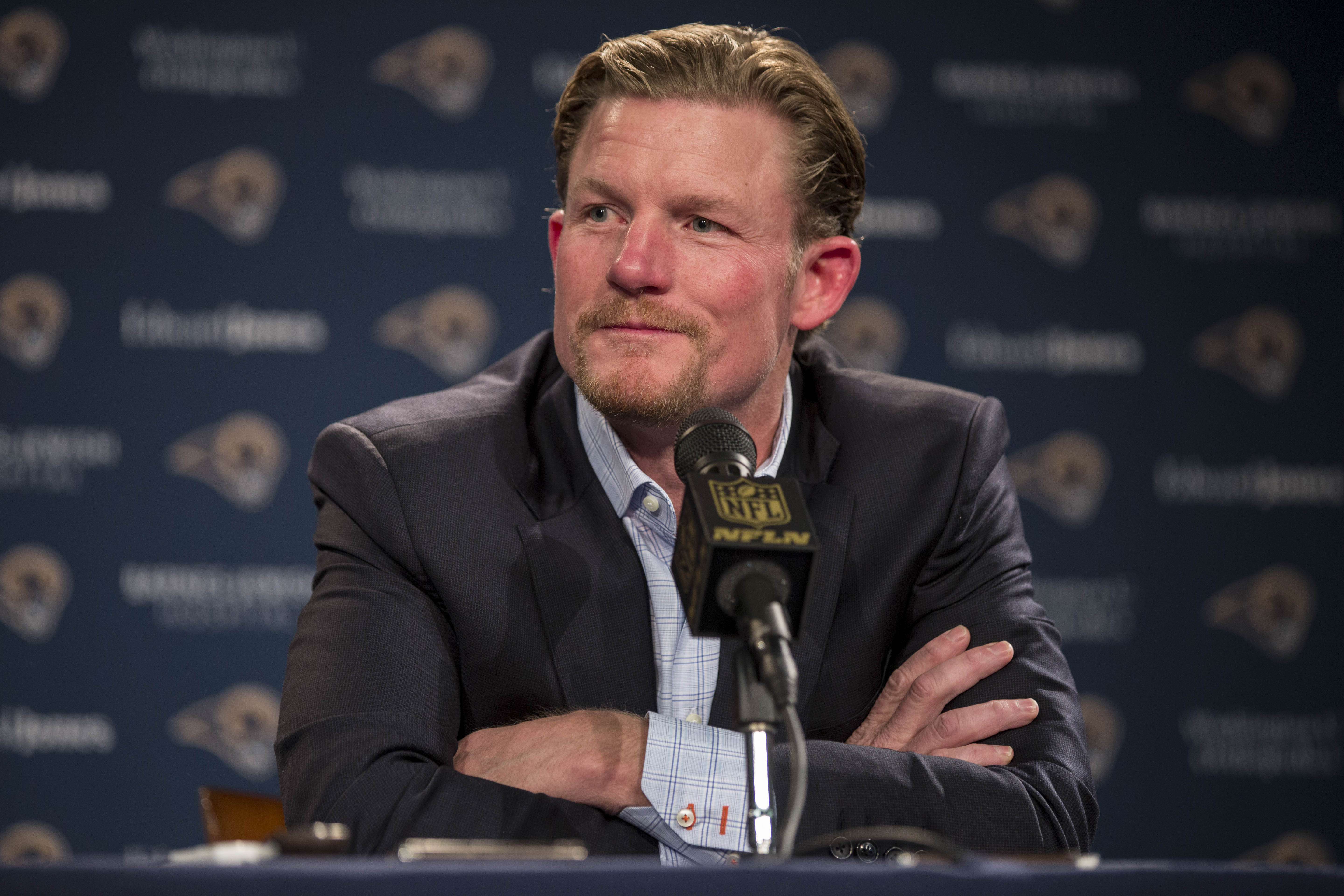 St. Louis Rams General Manager Les Snead introduces first-round draft pick Todd Gurley during a news conference at the NFL football team's practice facility Friday, May 1, 2015, in St. Louis. Gurley, a running back from Georgia, was picked tenth overall b