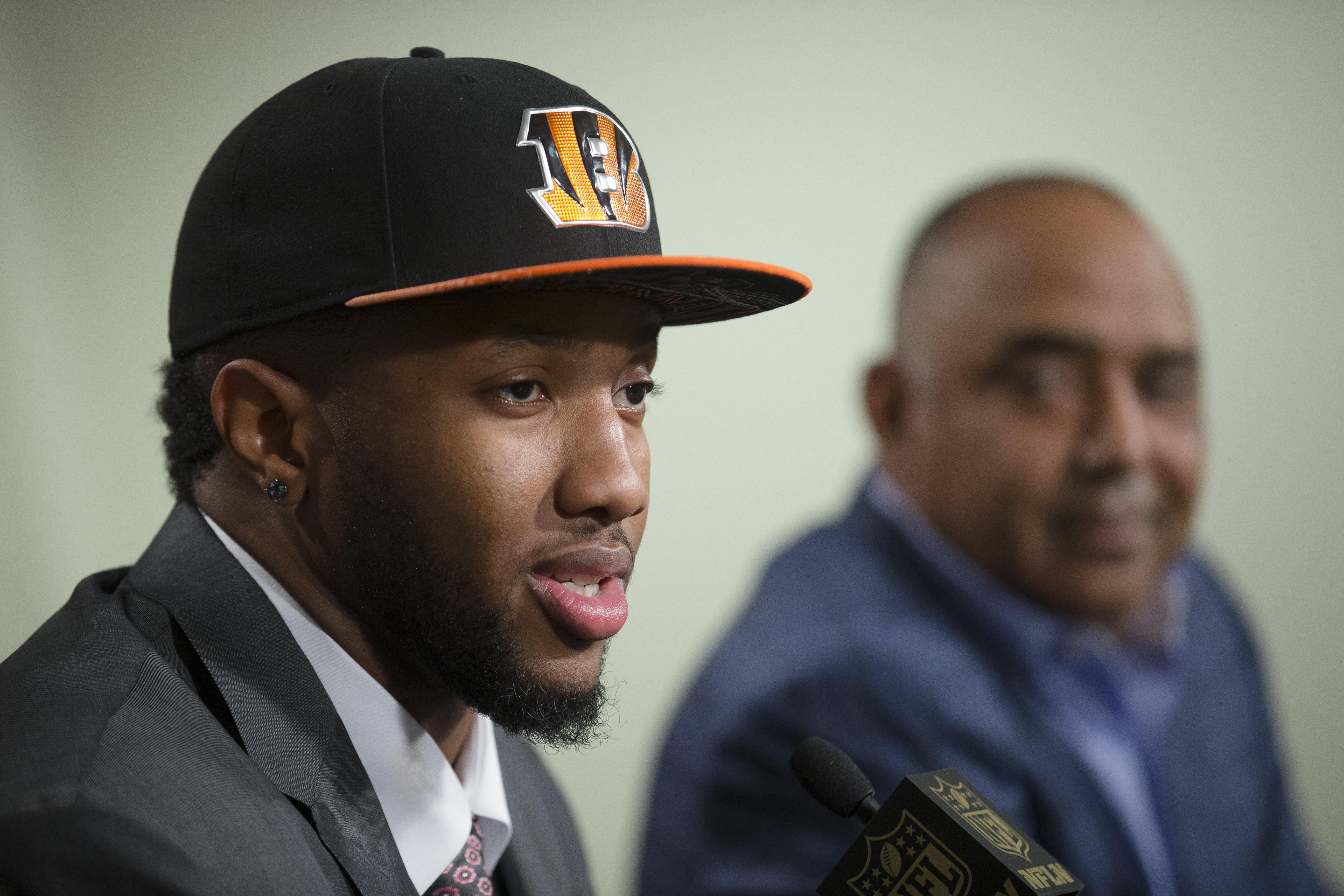The Cincinnati Bengals first-round draft pick Cedric Ogbuehi speaks alongside head coach Marvin Lewis, right, during a news conference at Paul Brown Stadium, Friday, May 1, 2015, in Cincinnati. The former Texas A&M offensive lineman was selected by the Be