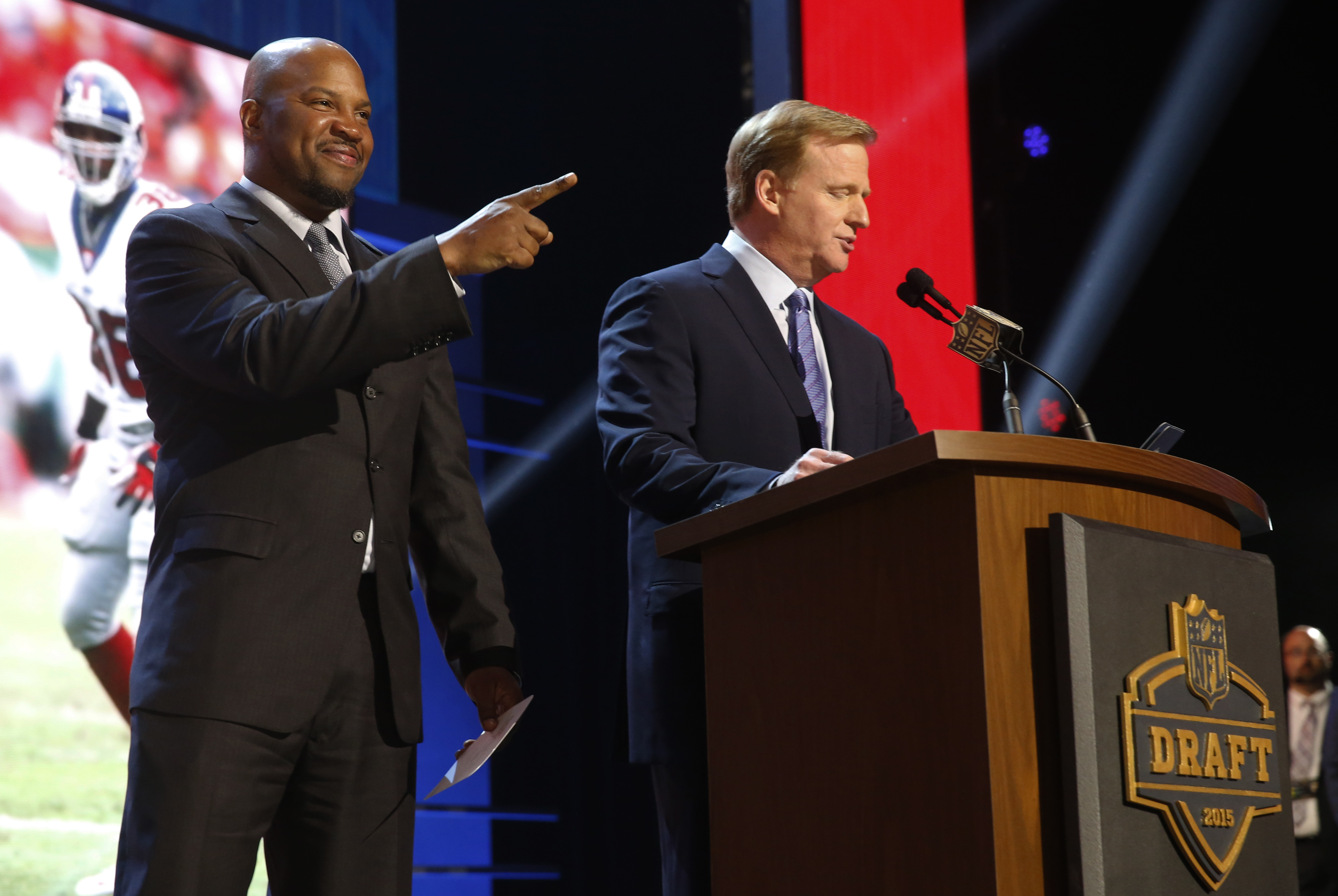 NFL commissioner Roger Goodell speaks before Shaun Williams, left, announces that the New York Giants selects Alabama defensive back Landon Collins as the 33rd pick in the second round of the 2015 NFL Football Draft,  Friday, May 1, 2015, in Chicago. (AP
