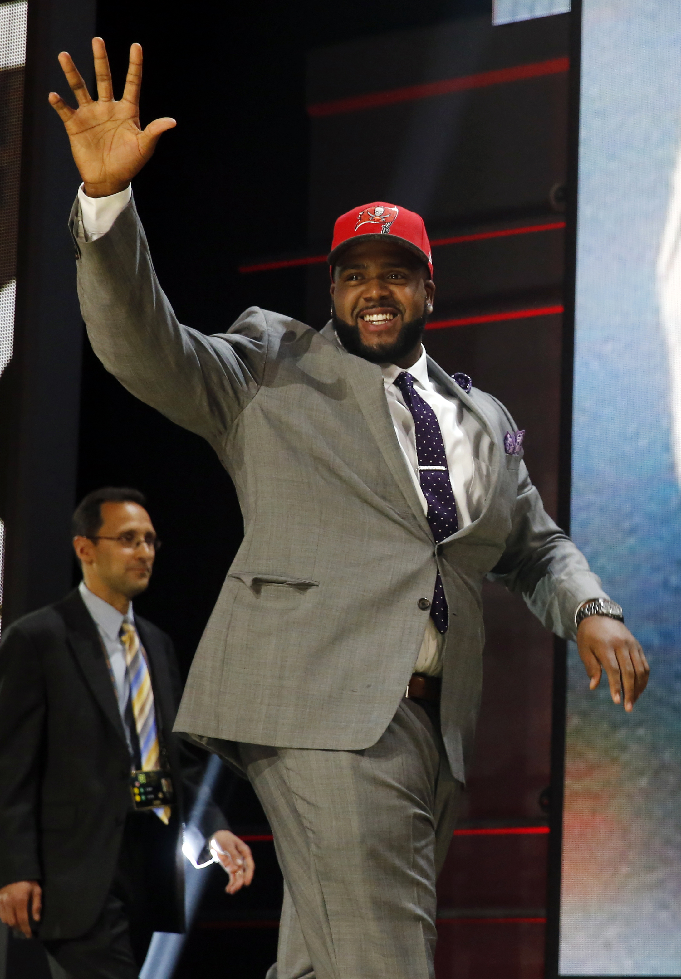 Penn State offensive lineman Donovan Smith celebrates after being selected by the Tampa Bay Buccaneers as the 34th pick in the second round of the 2015 NFL Football Draft,  Friday, May 1, 2015, in Chicago. (AP Photo/Charles Rex Arbogast)
