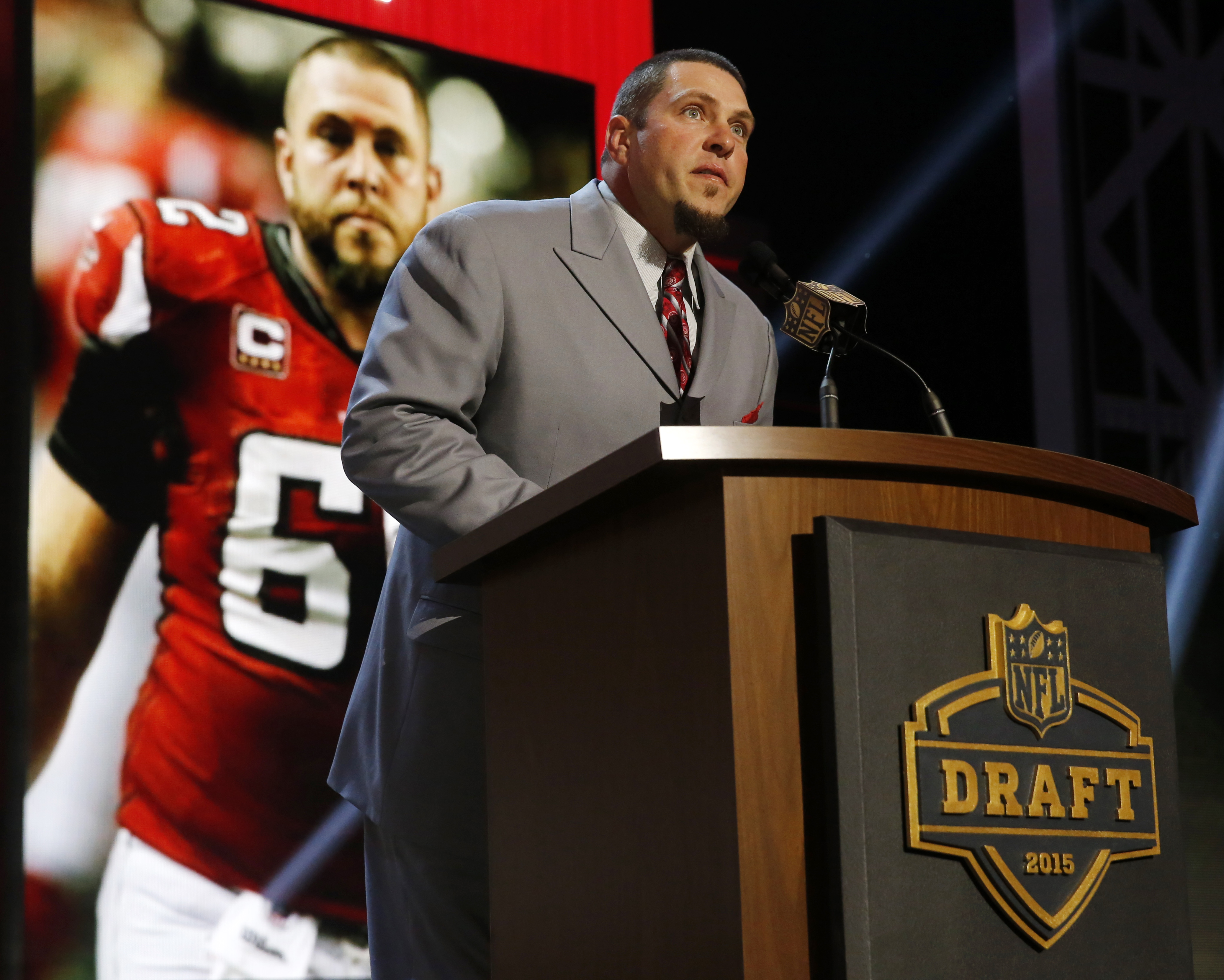 Former Atlanta Falcons center Todd McClure announces that the Falcons selects LSU defensive back Jalen Collins as the 42nd pick in the second round of the 2015 NFL Football Draft,  Friday, May 1, 2015, in Chicago. (AP Photo/Charles Rex Arbogast)