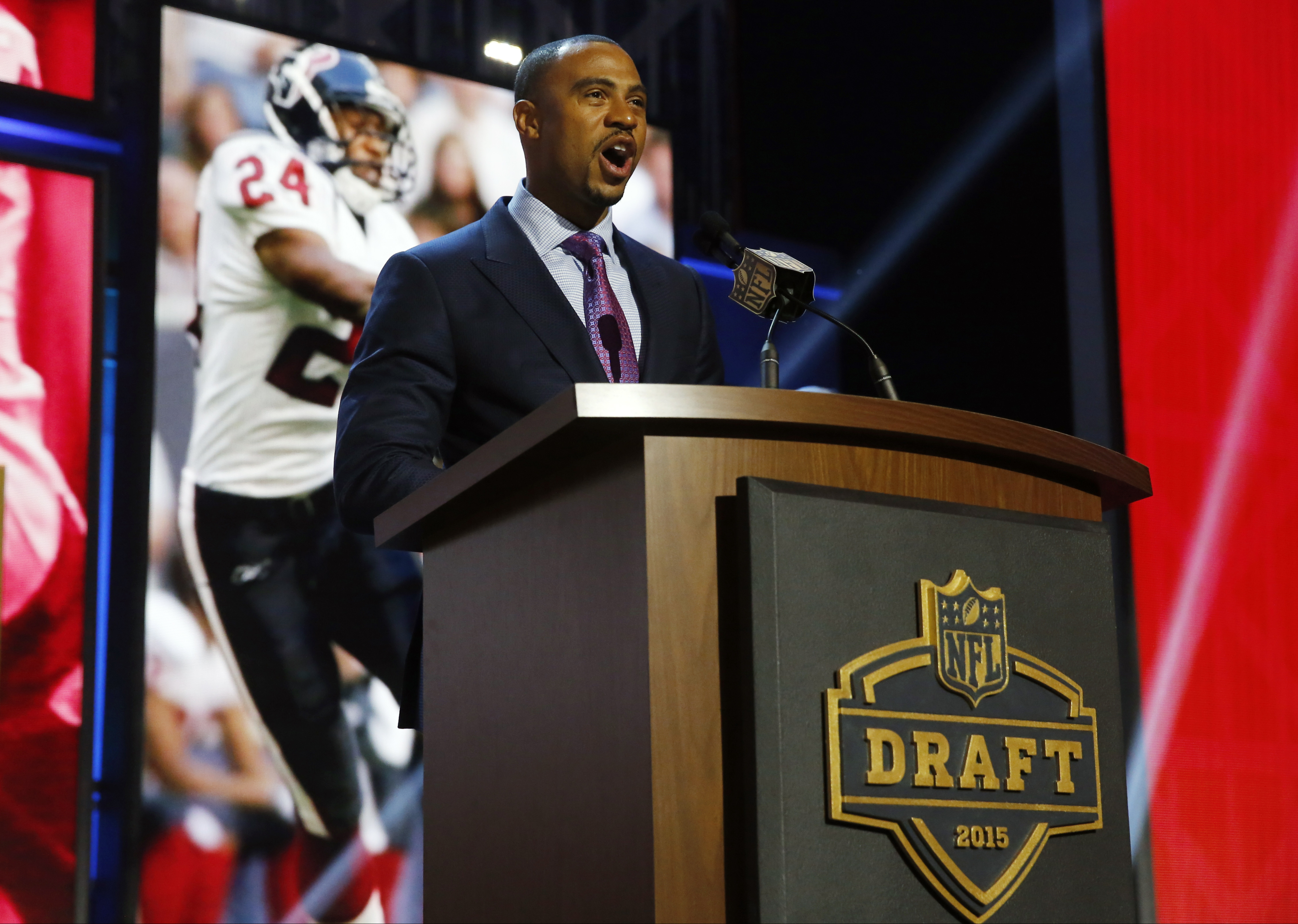 Former NFL player Eric Brown announces the Houston Texans selects Mississippi State linebacker Benardrick Mckinney as the 43rd pick in the second round of the 2015 NFL Football Draft,  Friday, May 1, 2015, in Chicago. (AP Photo/Charles Rex Arbogast)