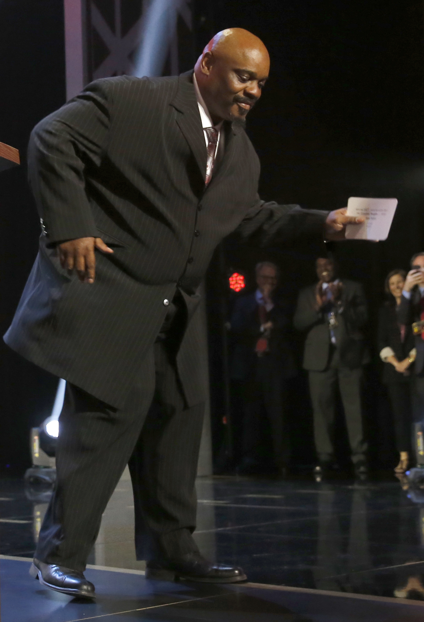 Former NFL player Cincinnati Bengals Ickey Woods does the Ickey Shuffle before he announces that the Bengals selects Oregon offensive lineman Jake Fisher as the 53rd pick in the second round of the 2015 NFL Football Draft,  Friday, May 1, 2015, in Chicago