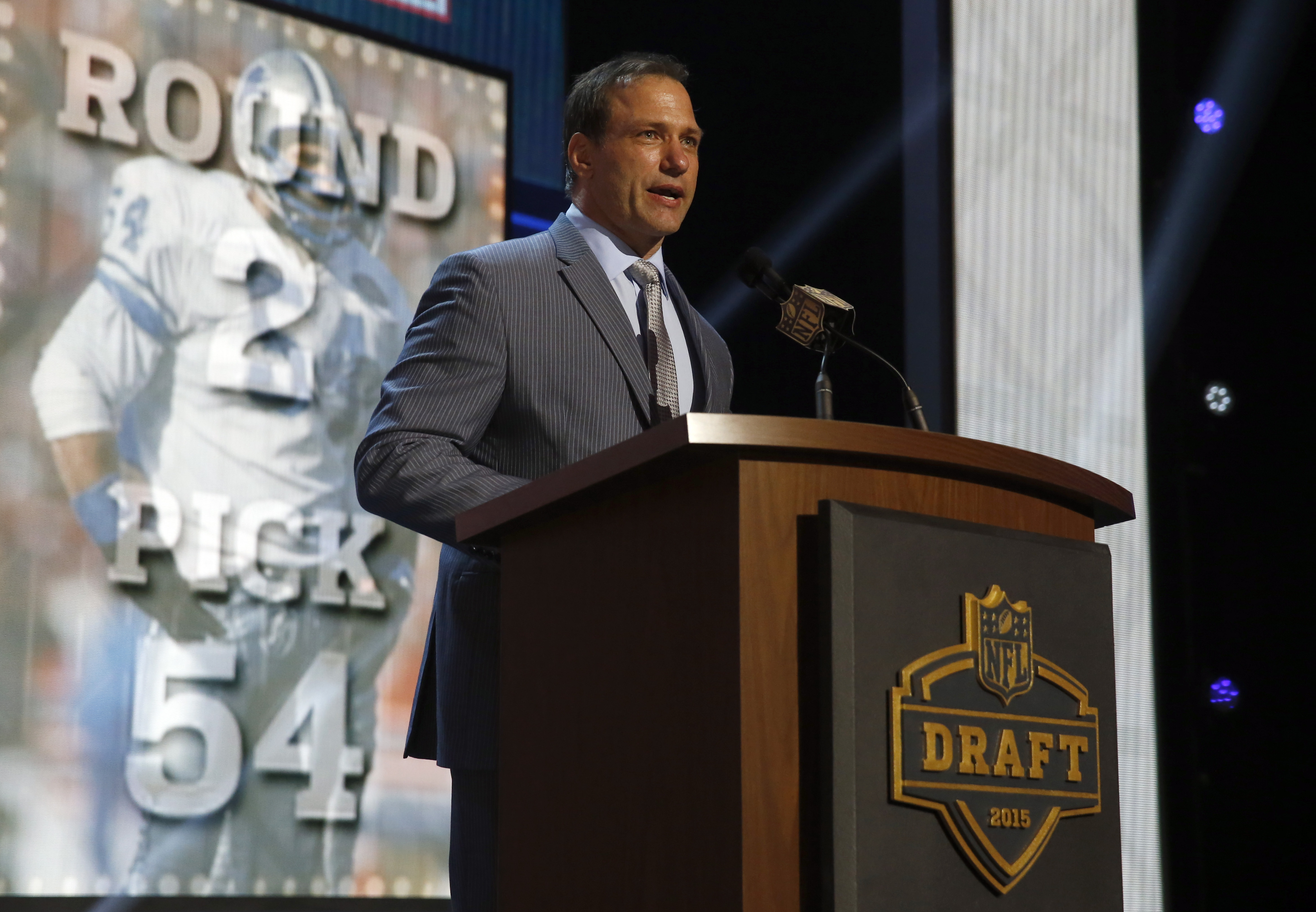 Former Detroit Lions player Chris Spielman announces that the Detroit Lions selects Nebraska running back Ameer Abdullah-as the 54th pick in the second round of the 2015 NFL Football Draft,  Friday, May 1, 2015, in Chicago. (AP Photo/Charles Rex Arbogast)