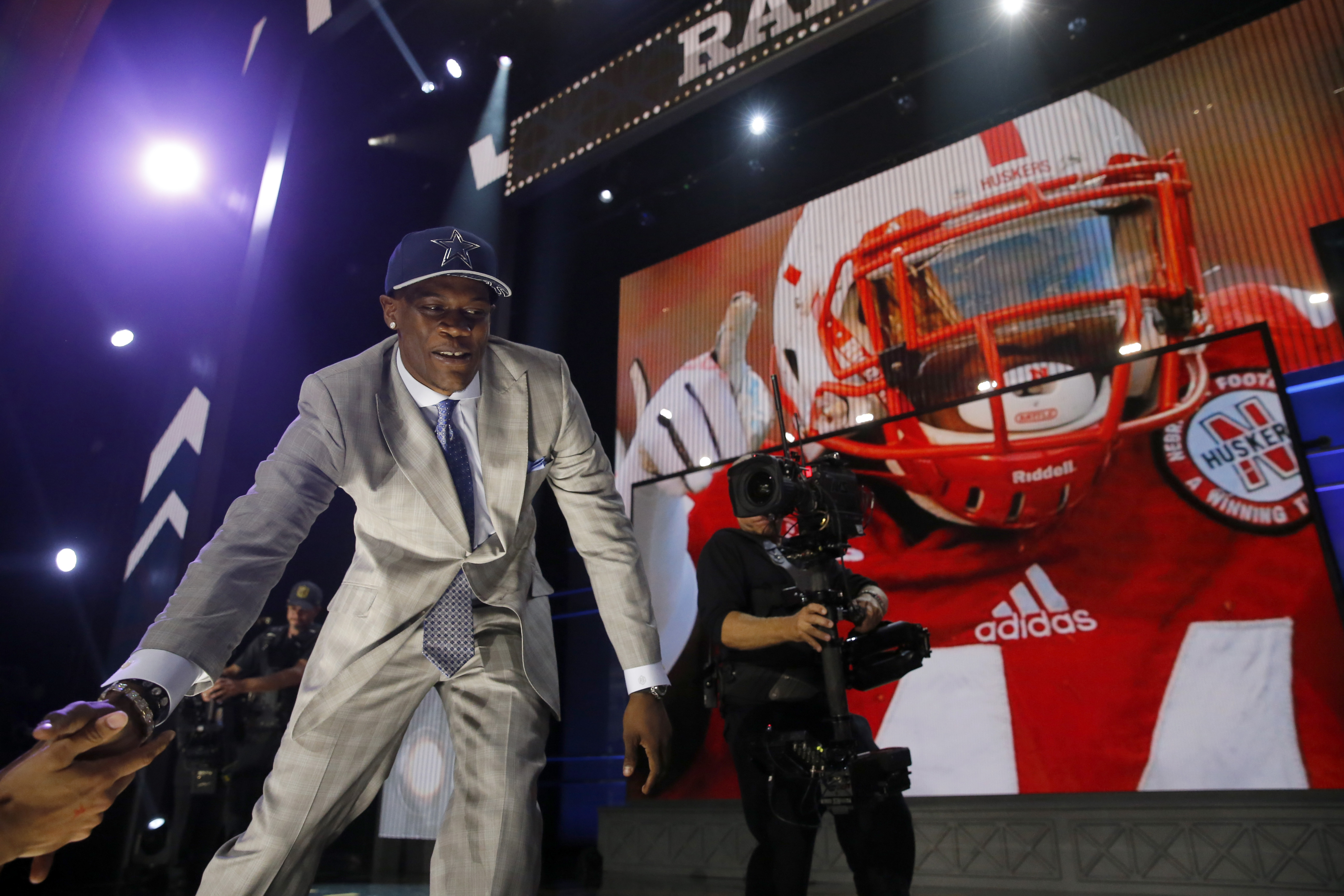 Nebraska defensive lineman Randy Gregory celebrates after being selected by the Dallas Cowboys as the 60th pick in the second round of the 2015 NFL Football Draft,  Friday, May 1, 2015, in Chicago. (AP Photo/Charles Rex Arbogast)