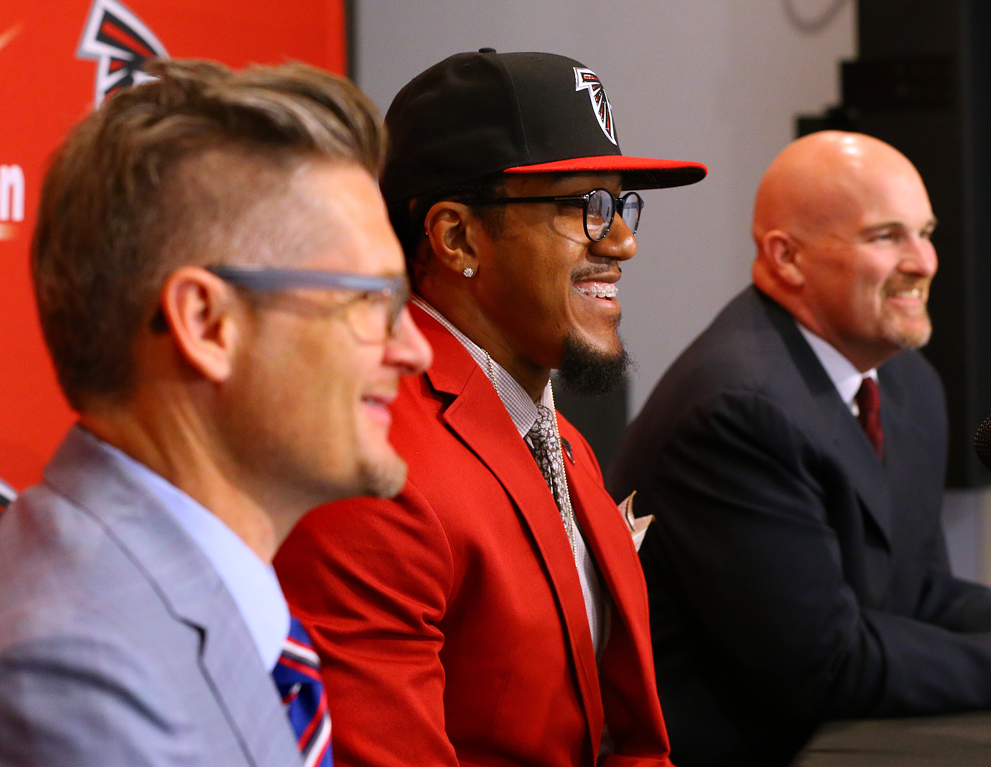 Atlanta Falcons General Manager Thomas Dimitroff, left, attends a news conference with first-round draft pick Vic Beasley, center, and head coach Dan Quinn at the Falcons training facility on Friday, May 1, 2015, in Flowery Branch, Ga. (Curtis Compton/Atl
