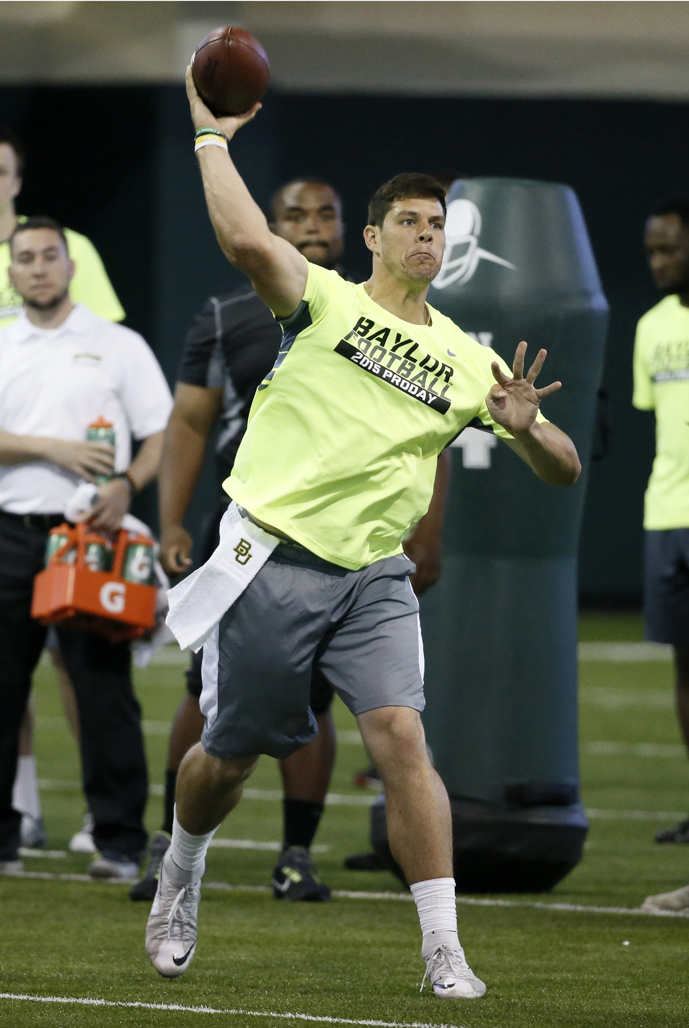 Quarterback Bryce Petty passes as he works out for scouts at Baylor NFL football Pro Day in Waco, Texas, Wednesday March 18, 2015. (AP Photo/Tony Gutierrez)