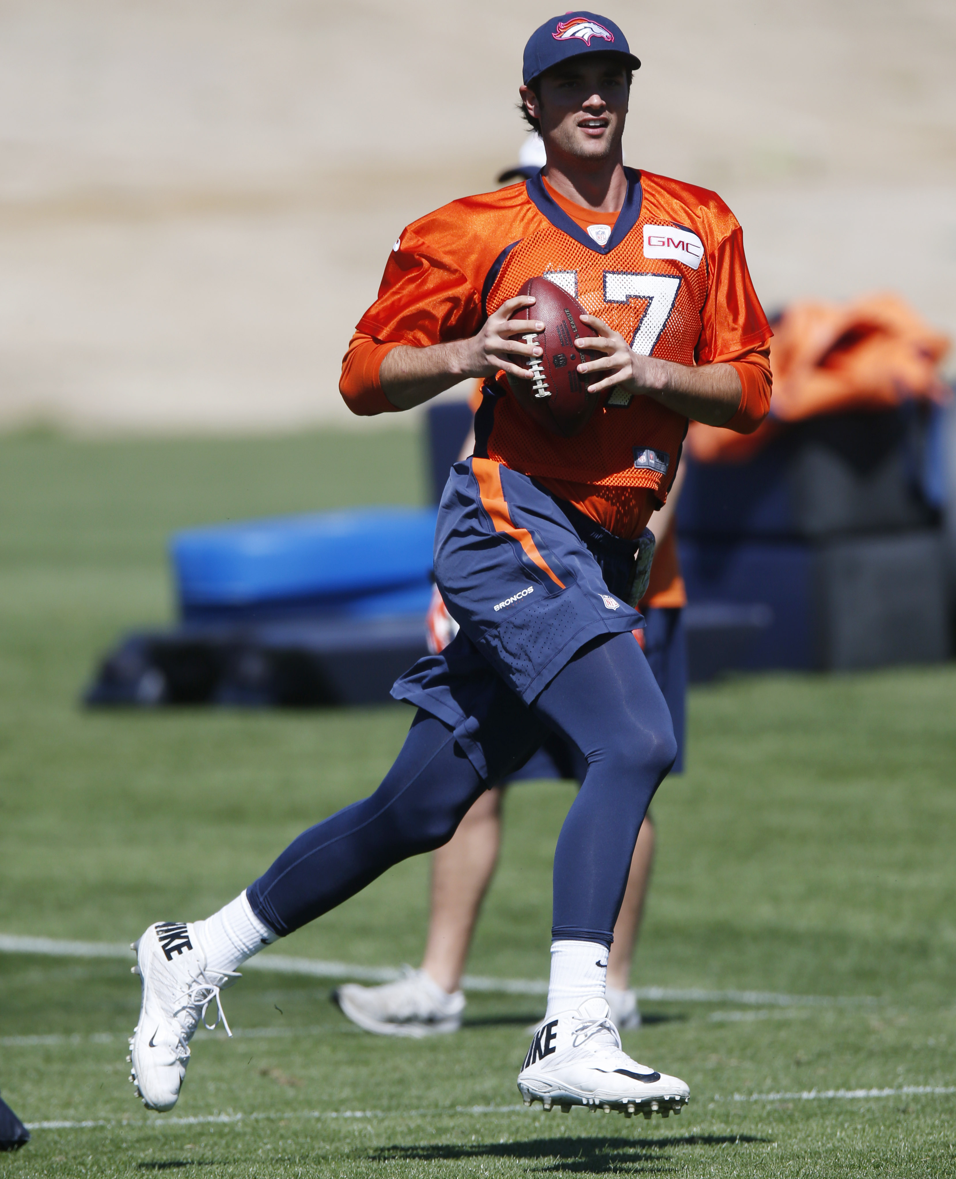 FILE - In this April 29, 2015, file photo, Denver Broncos quarterback Brock Osweiler completes a drill during the second day of the NFL football team's two-day voluntary veterans minicamp in Englewood, Colo. Brock Osweiler got married this offseason and t