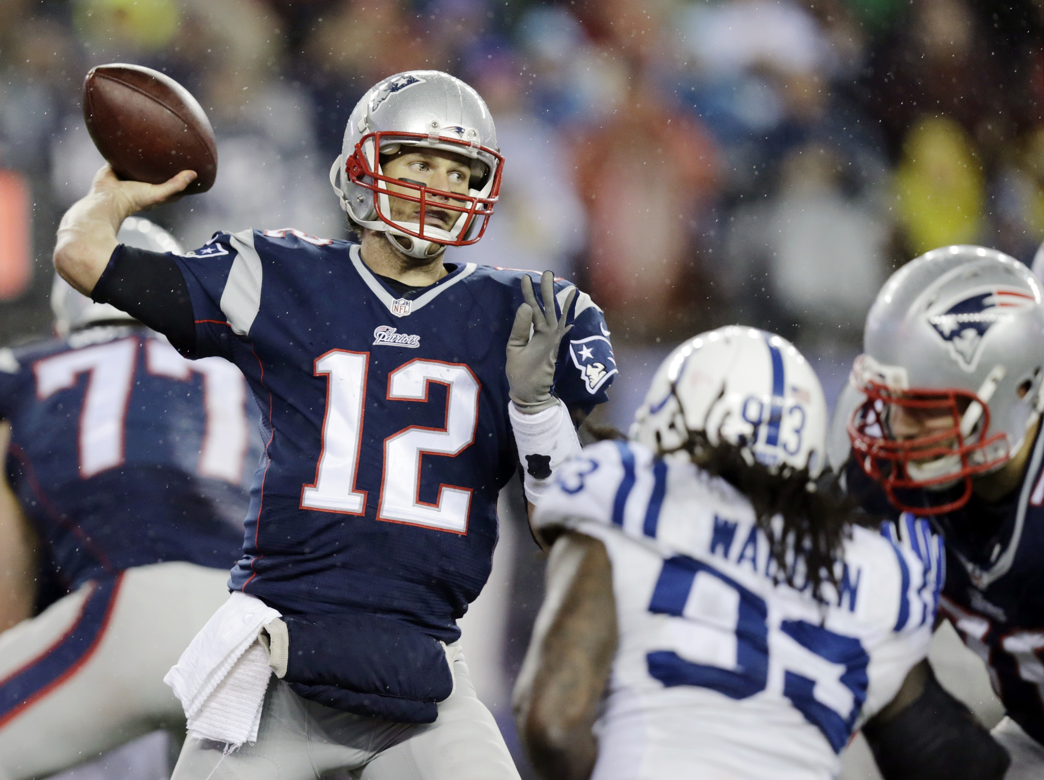 FILE - In this Jan. 18, 2015, file photo, New England Patriots quarterback Tom Brady (12)  passes against the Indianapolis Colts during the second half of the NFL football AFC Championship game in Foxborough, Mass. An NFL investigation has found that New