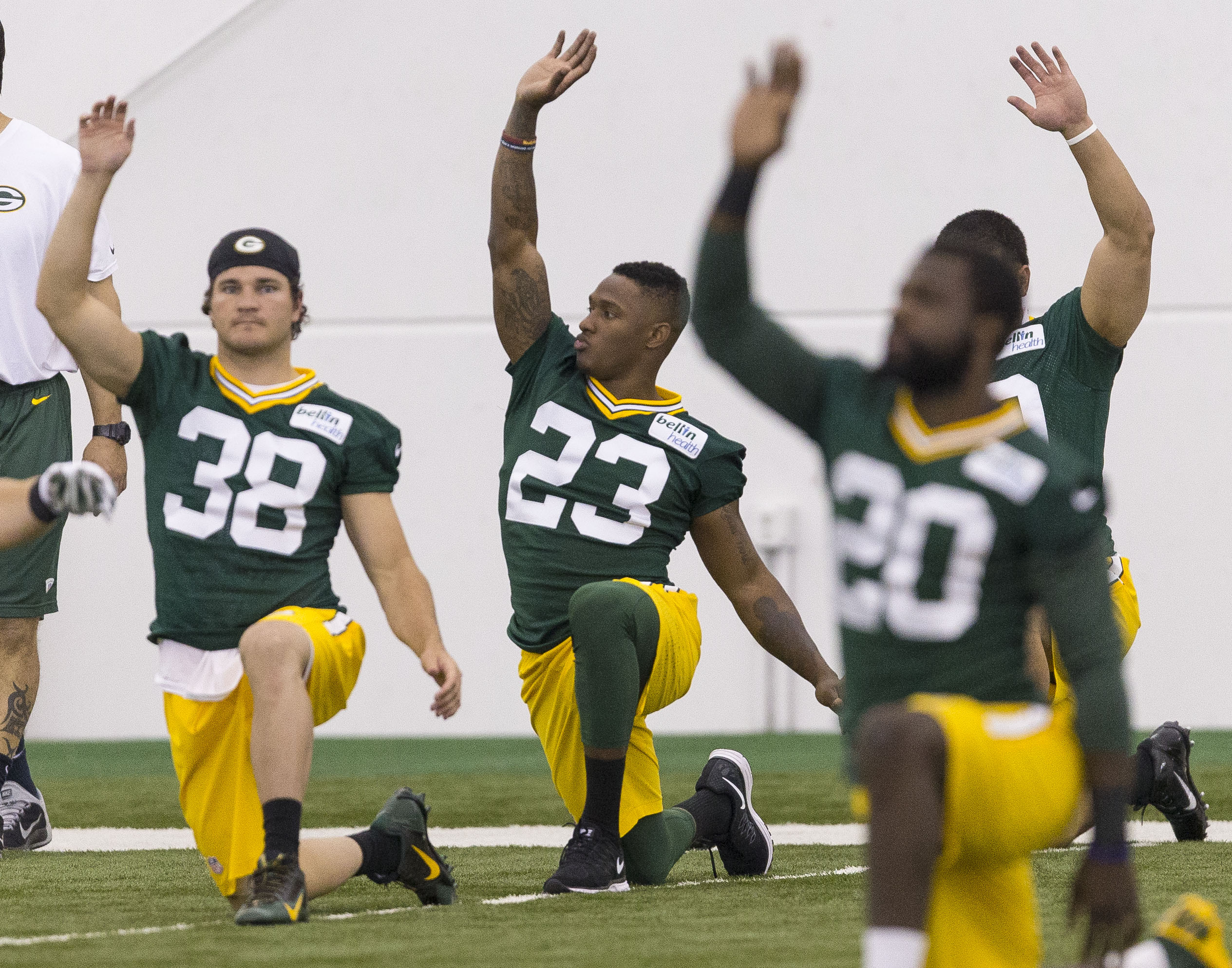 Green Bay Packers first round draft pick Damarious Randall (23) and Skye PoVey (38) stretch during NFL football minicamp Friday, May 8, 2015 in Green Bay, Wis.   (AP Photo / Mike Roemer)