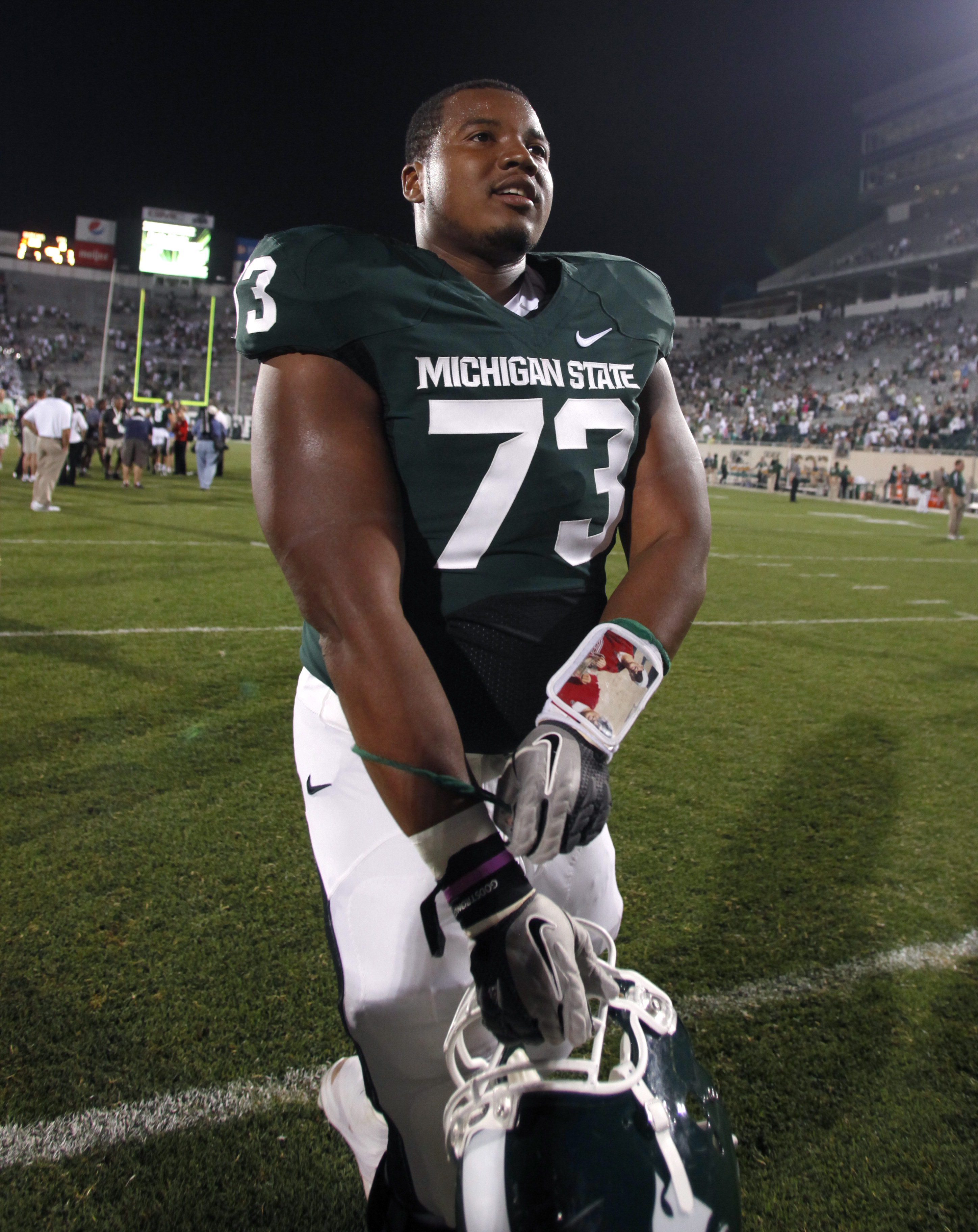 FILE - This Sept. 2, 2011, file photo shows Michigan State offensive lineman Arthur Ray Jr. leaves the field following a 28-6 win over Youngstown State in an NCAA college football game, in East Lansing, Mich. Offensive lineman Arthur Ray Jr. is among 26 p