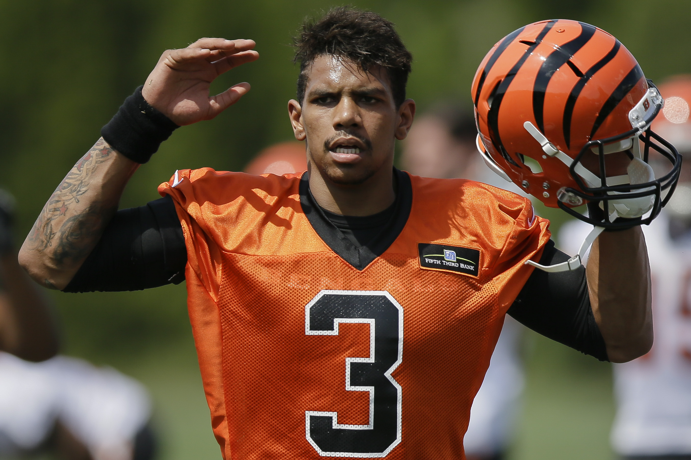 Cincinnati Bengals NFL football quarterback Terrelle Pryor participates in a drill during NFL football rookie minicamp in Cincinnati, Friday, May 8, 2015. (AP Photo/John Minchillo)