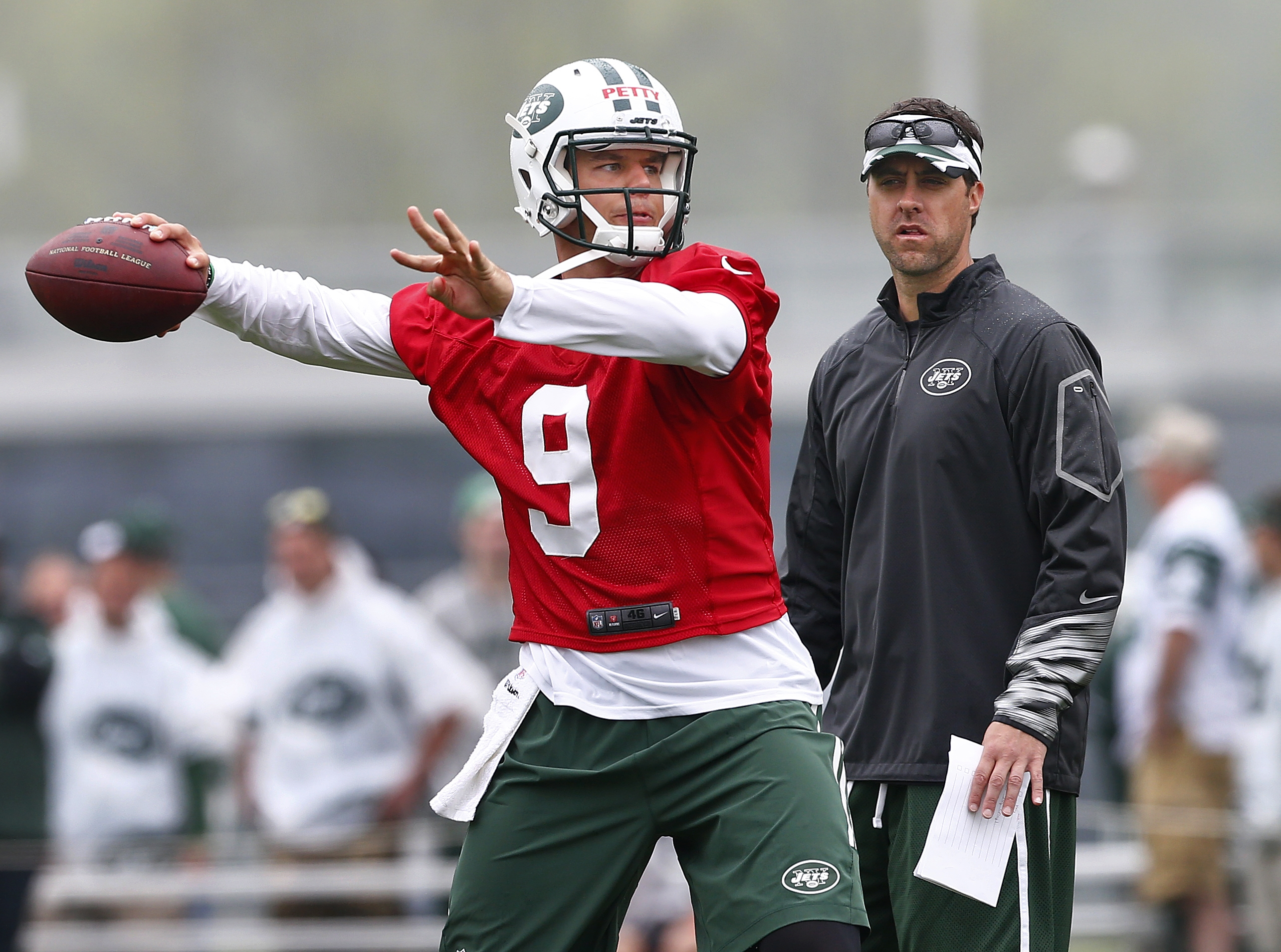 New York Jets quarterback Bryce Petty (9) throws a pass as quarterbacks coach Kevin Patullo watches during practice at the team's NFL football rookie minicamp, Saturday, May 9, 2015, in Florham Park, N.J. (AP Photo/Rich Schultz)