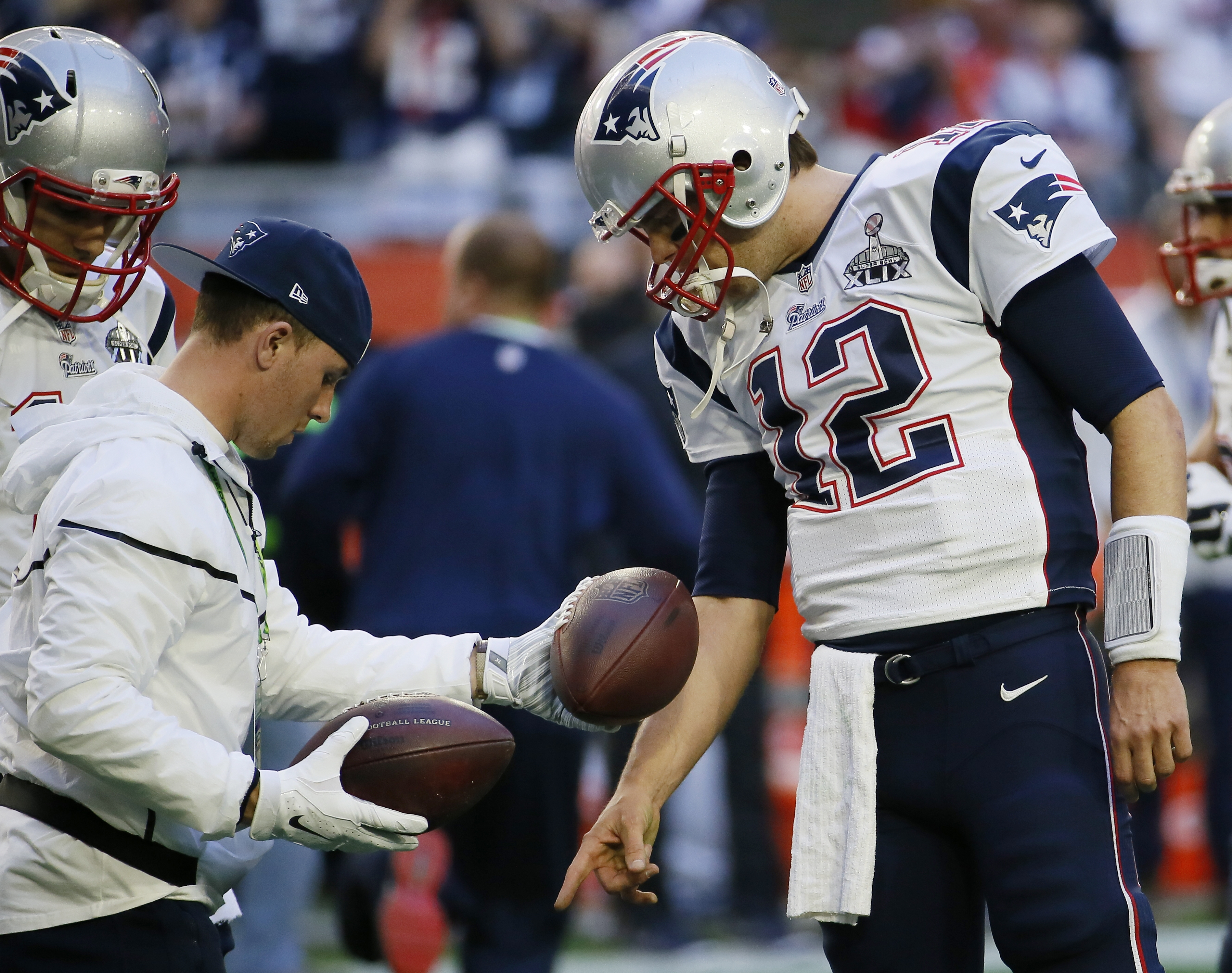 FILE - In this Feb. 1, 2015, file photo, New England Patriots quarterback Tom Brady (12) warms up before the NFL Super Bowl XLIX football game against the Seattle Seahawks in Glendale, Ariz. Tom Brady is expected to file an appeal of his four-game suspens