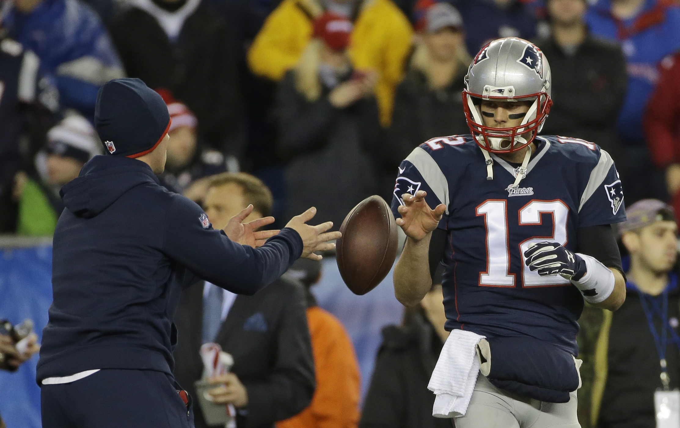 FILE - In this Jan. 18, 2015, file photo, New England Patriots quarterback Tom Brady has a ball tossed to him during warmups before the NFL football AFC Championship game against the Indianapolis Colts in Foxborough, Mass. Tom Brady is expected to file an