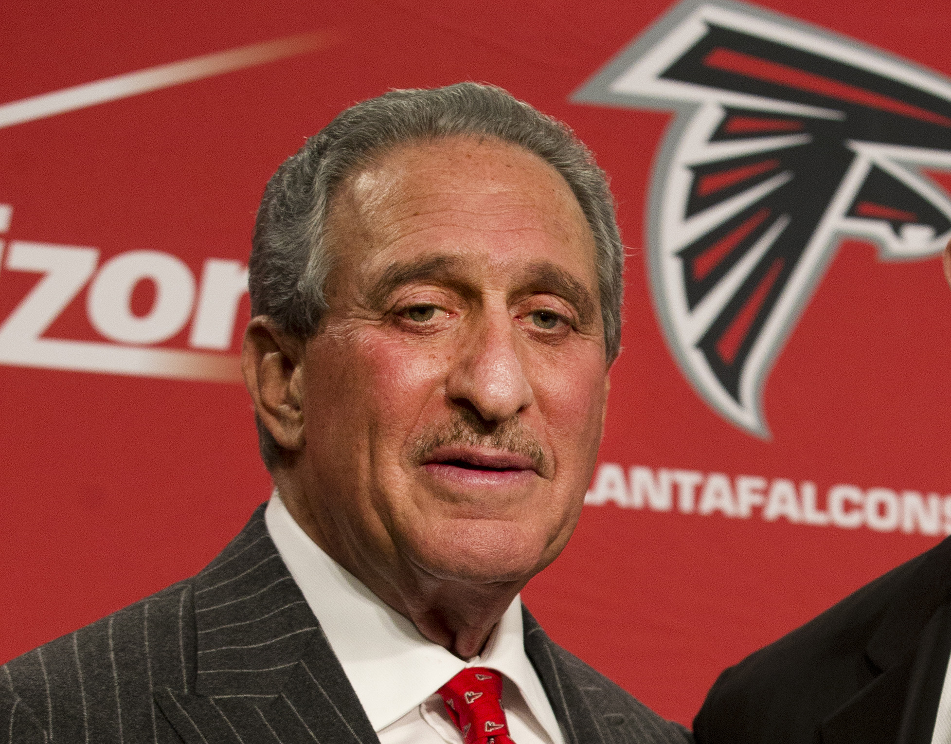 """FILE - In this Feb. 3, 2015, file photo, Atlanta Falcons owner Arthur Blank poses after  a news conference in Flowery Branch, Ga. Blank says there is a """"general feeling"""" that the Patriots' failure to acknowledge mistakes hurt the them when it came to the"""