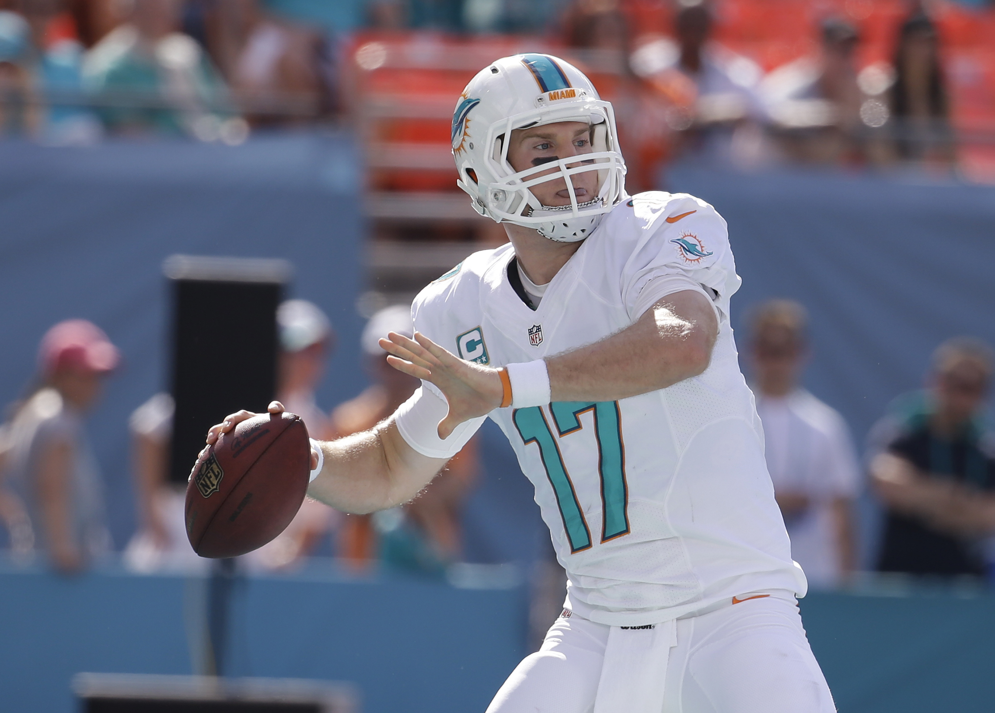 Miami Dolphins quarterback Ryan Tannehill (17) looks to pass during the first half of an NFL football game against the New York Jets, Sunday, Dec. 28, 2014, in Miami Gardens, Fla. (AP Photo/Lynne Sladky)