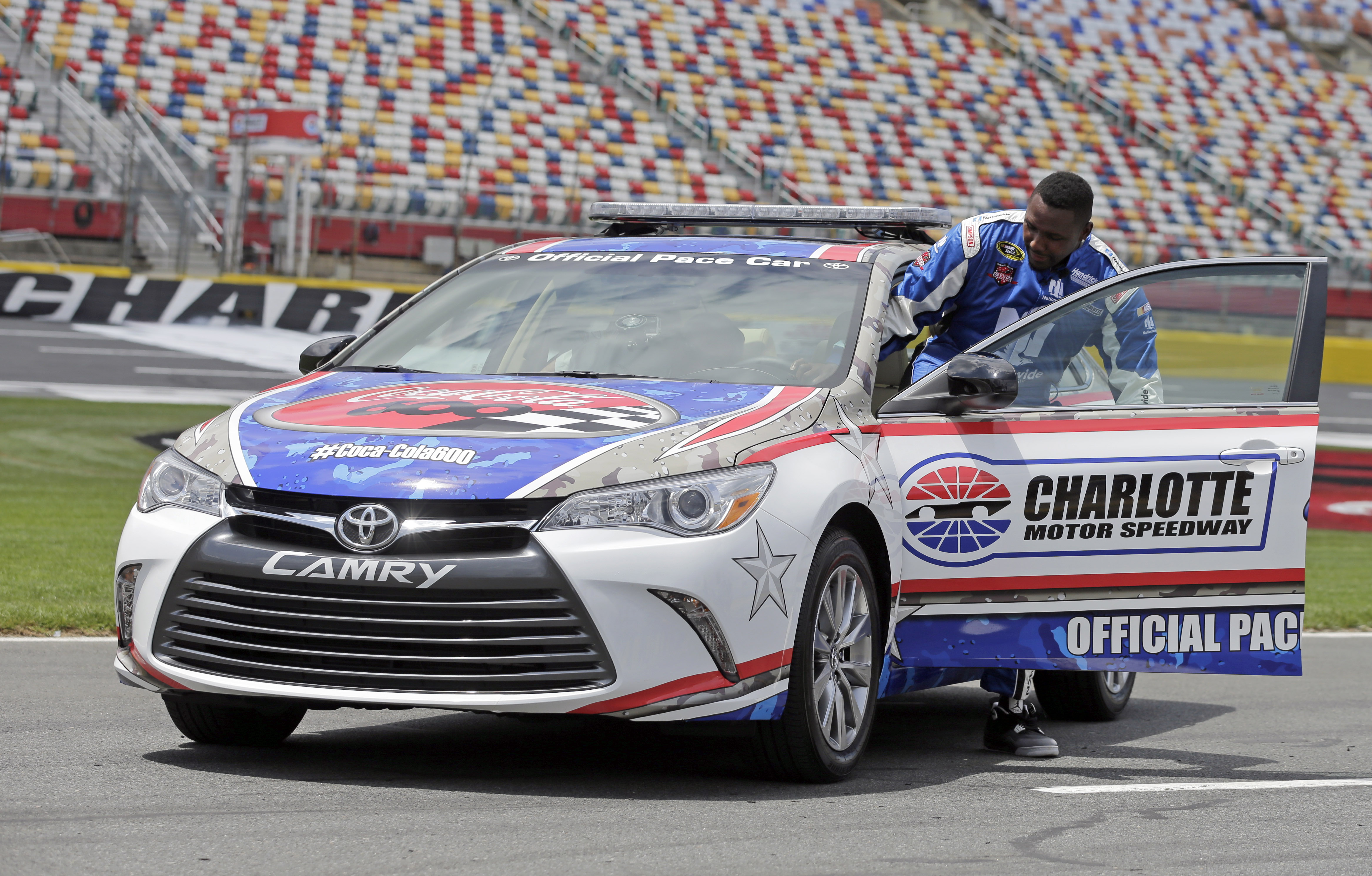 Carolina Panthers linebacker Thomas Davis climbs into the pace car at Charlotte Motor Speedway for his certification laps during a news conference in Concord, N.C., Tuesday, May 19, 2015. Davis, the NFL's Man of the Year, has been selected to be the honor