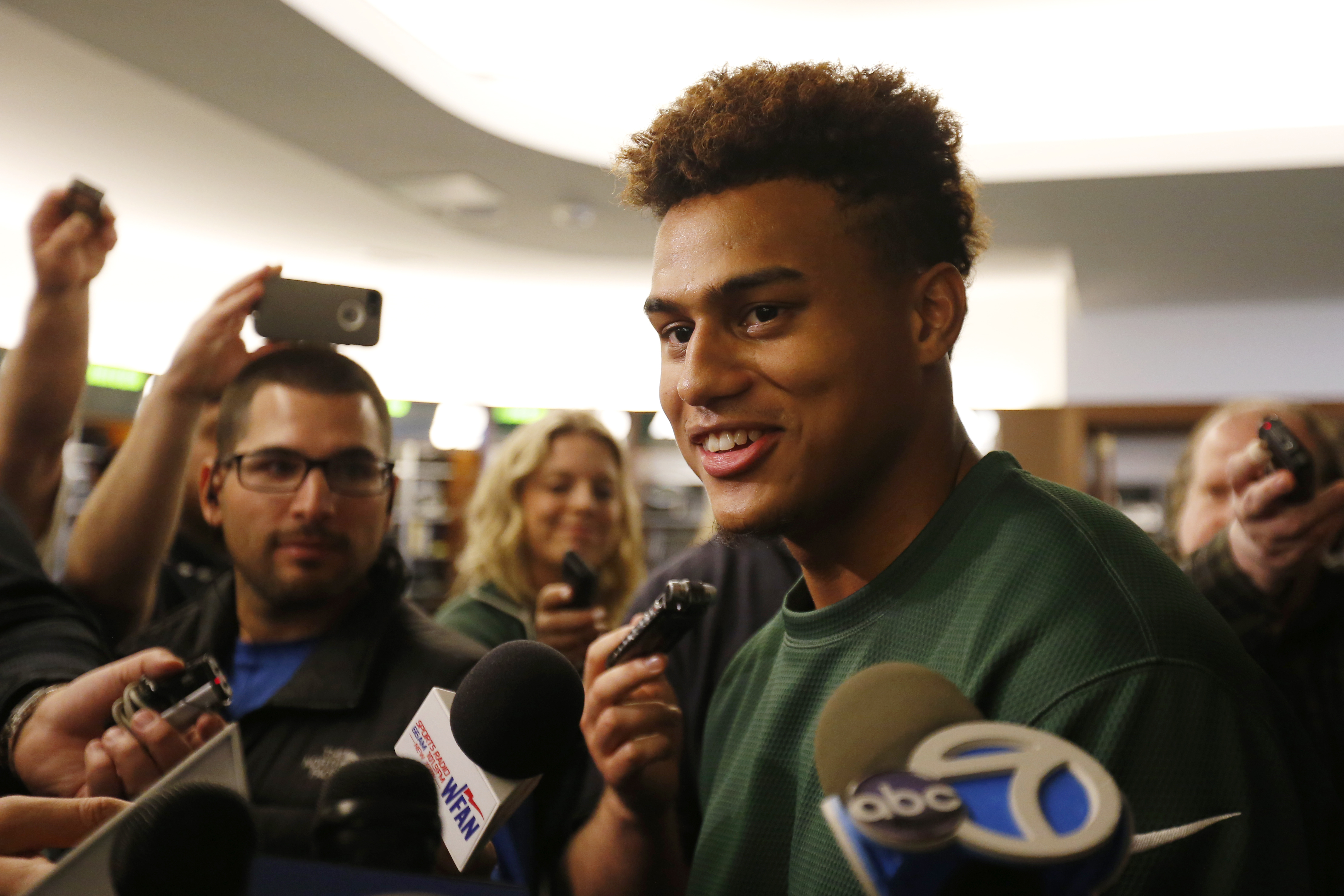 New York Jets cornerback Dexter McDougle speaks to reporters during an NFL football organized team activity, Wednesday, May 20, 2015, in Florham Park, N.J. (AP Photo/Julio Cortez)