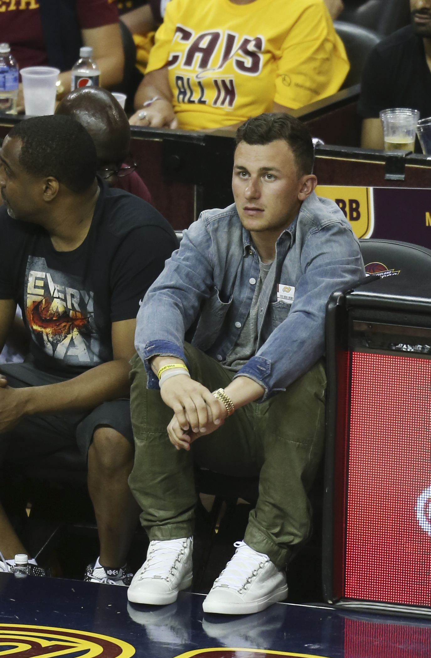 Cleveland Browns quarterback Johnny Manziel watches during the second half in Game 3 of the Eastern Conference finals of the NBA basketball playoffs between the Atlanta Hawks and Cleveland Cavaliers Sunday, May 24, 2015, in Cleveland. (AP Photo/Ron Schwan