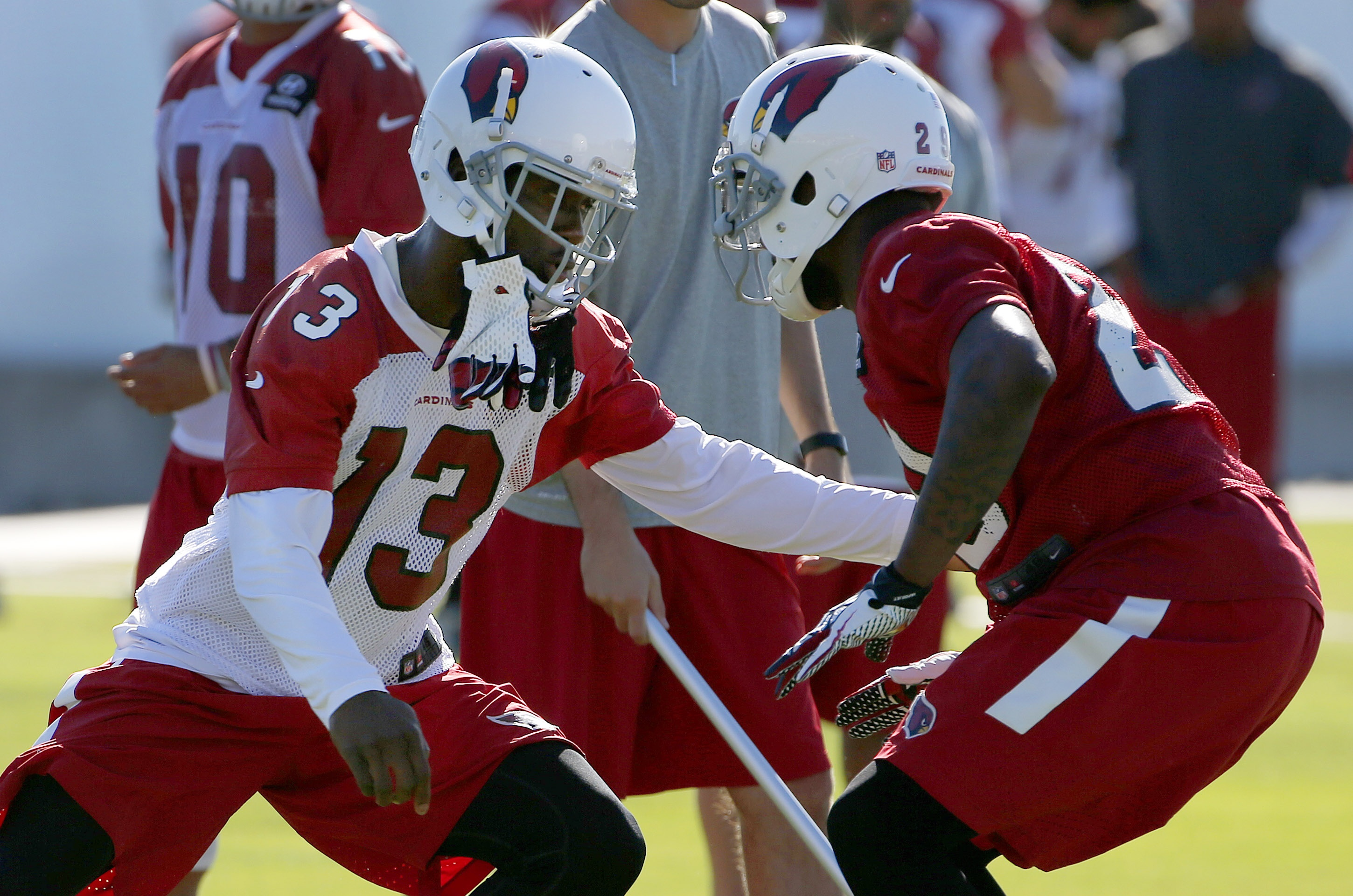 Arizona Cardinals wide receiver Jaron Brown (13) tries to get past safety Chris Clemons (29) during an NFL football organized team activity Monday, June 1, 2015, in Tempe, Ariz. (AP Photo/Ross D. Franklin)