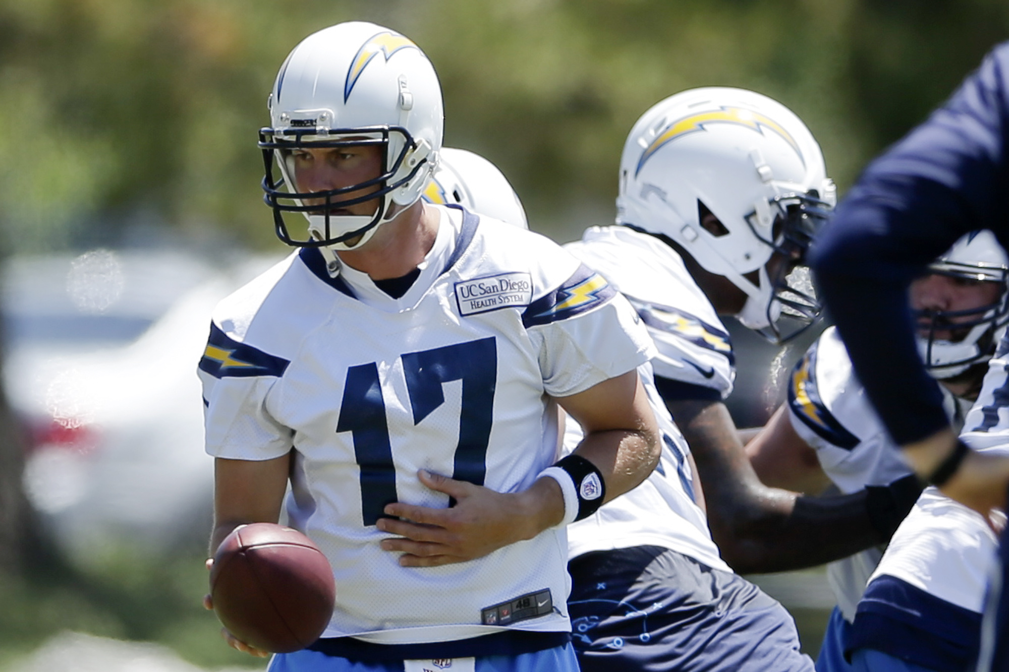 San Diego Chargers quarterback Philip Rivers runs a play during an NFL football organized training activity Monday, June 1, 2015, in San Diego. (AP Photo/Gregory Bull)
