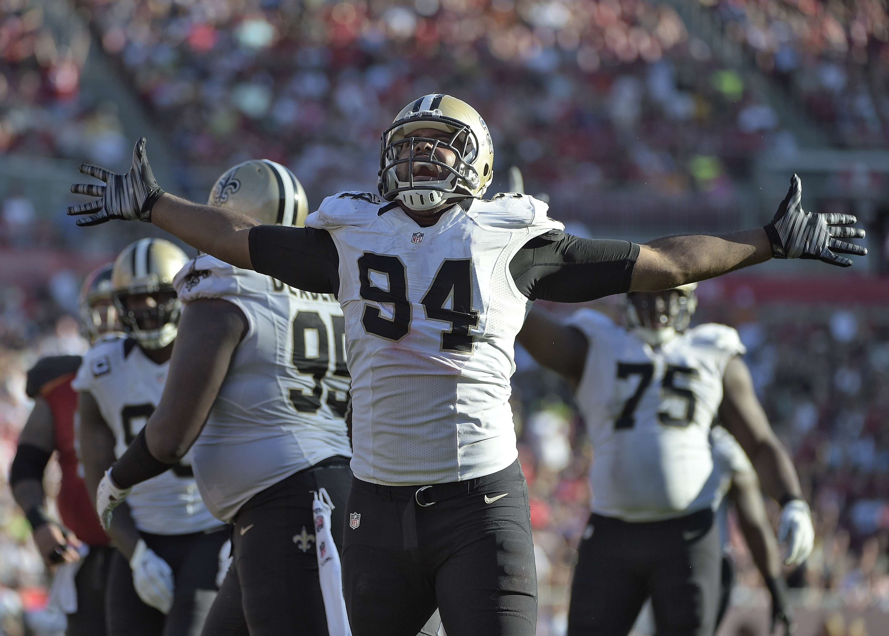 New Orleans Saints defensive end Cameron Jordan (94) celebrates after stopping the Tampa Bay Buccaneers on a run during the fourth quarter of an NFL football game Sunday, Dec. 28, 2014, in Tampa, Fla. (AP Photo/Phelan M. Ebenhack)
