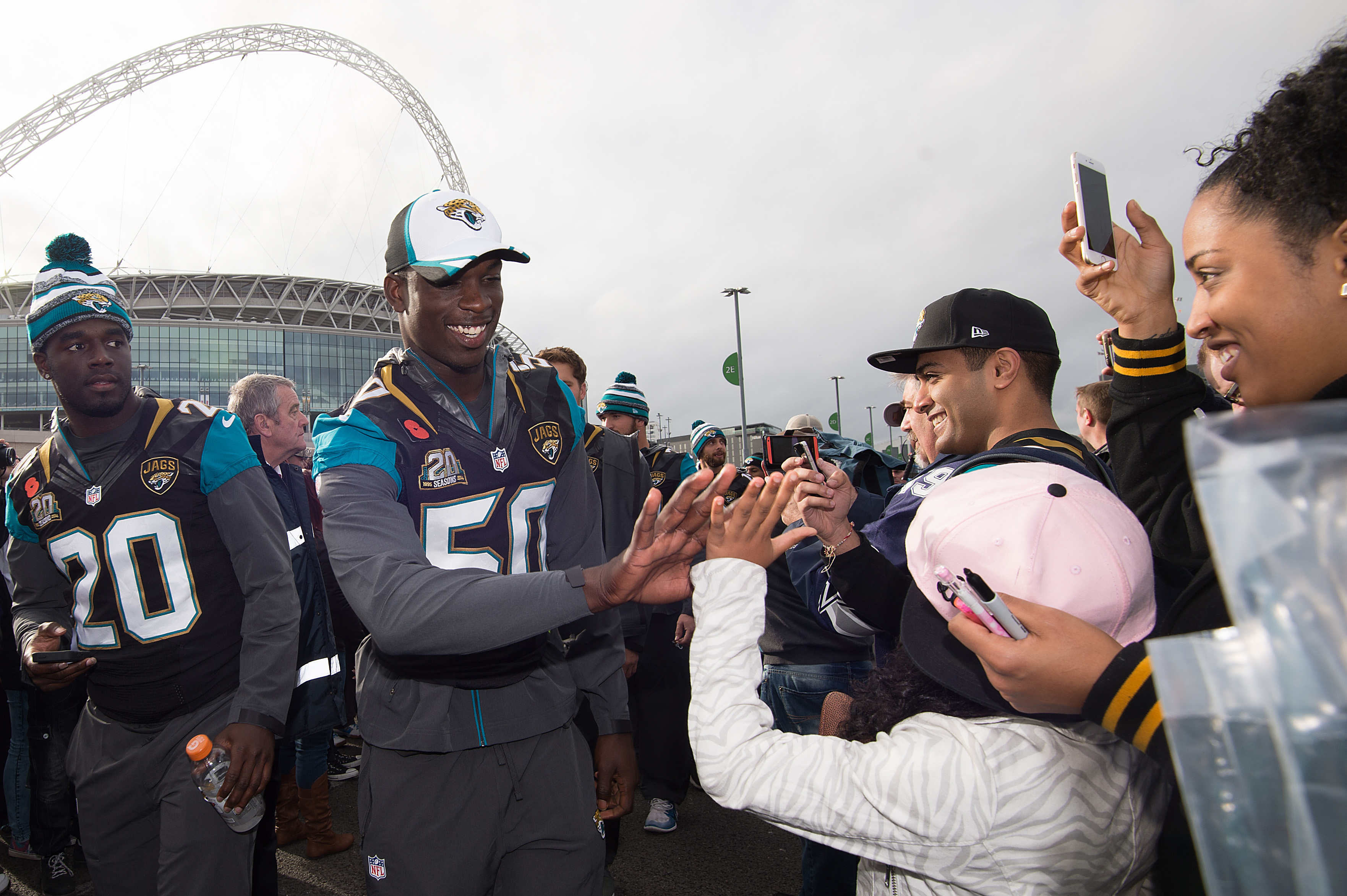 FILE - In this November, 2014, file photo, Jacksonville Jaguars linebacker Telvin Smith, center, greets fans as he arrives during the NFL Fan Rally outside Wembley Stadium in London, before a football game against the Dallas Cowboys. NFL Commissioner Roge