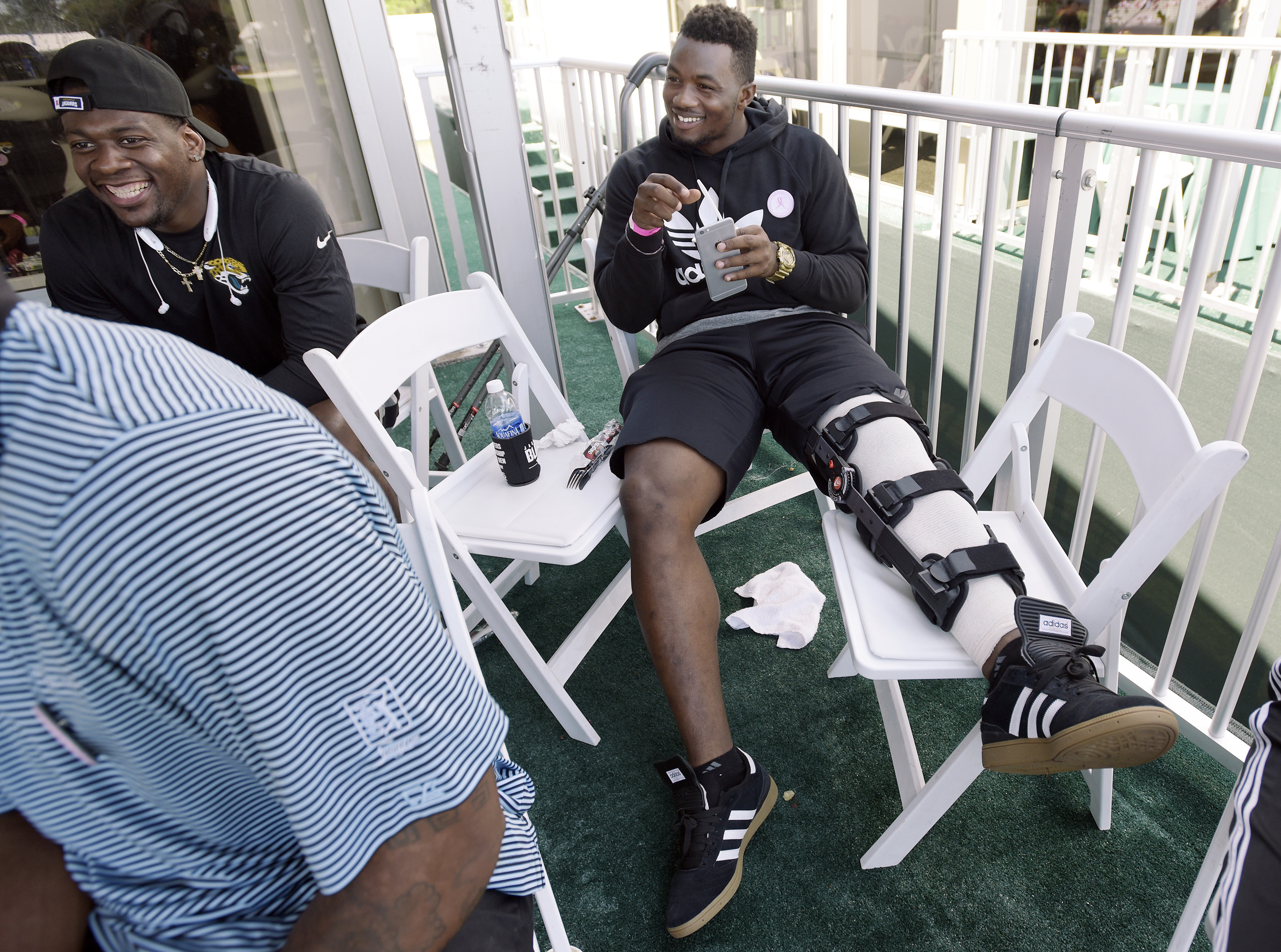 FILE - In this May 10, 2015, file photo, Jacksonville Jaguars first draft pick Dante Fowler Jr. sits with other team rookies in a tent overlooking the 17 green during the final round of The Players Championship golf tournament in Ponte Vedra Beach, Fla. F