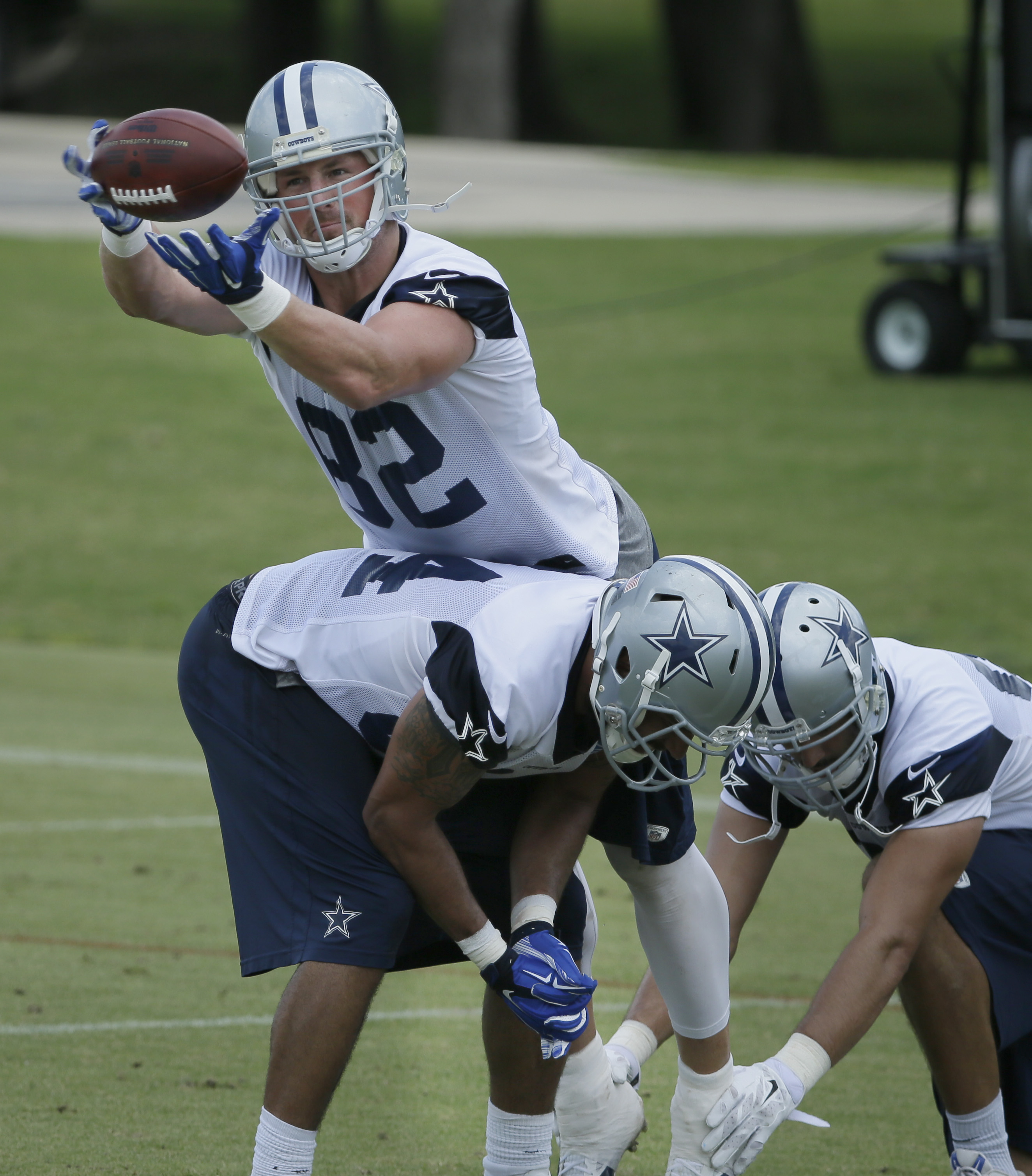 Dallas Cowboys tight end Jason Witten (82) runs a catching drill with fellow tight ends James Hanna (84) and Gavin Escobar, right, during an NFL football organized team activity,  Wednesday, June 3, 2015, in Irving, Texas. (AP Photo/LM Otero)
