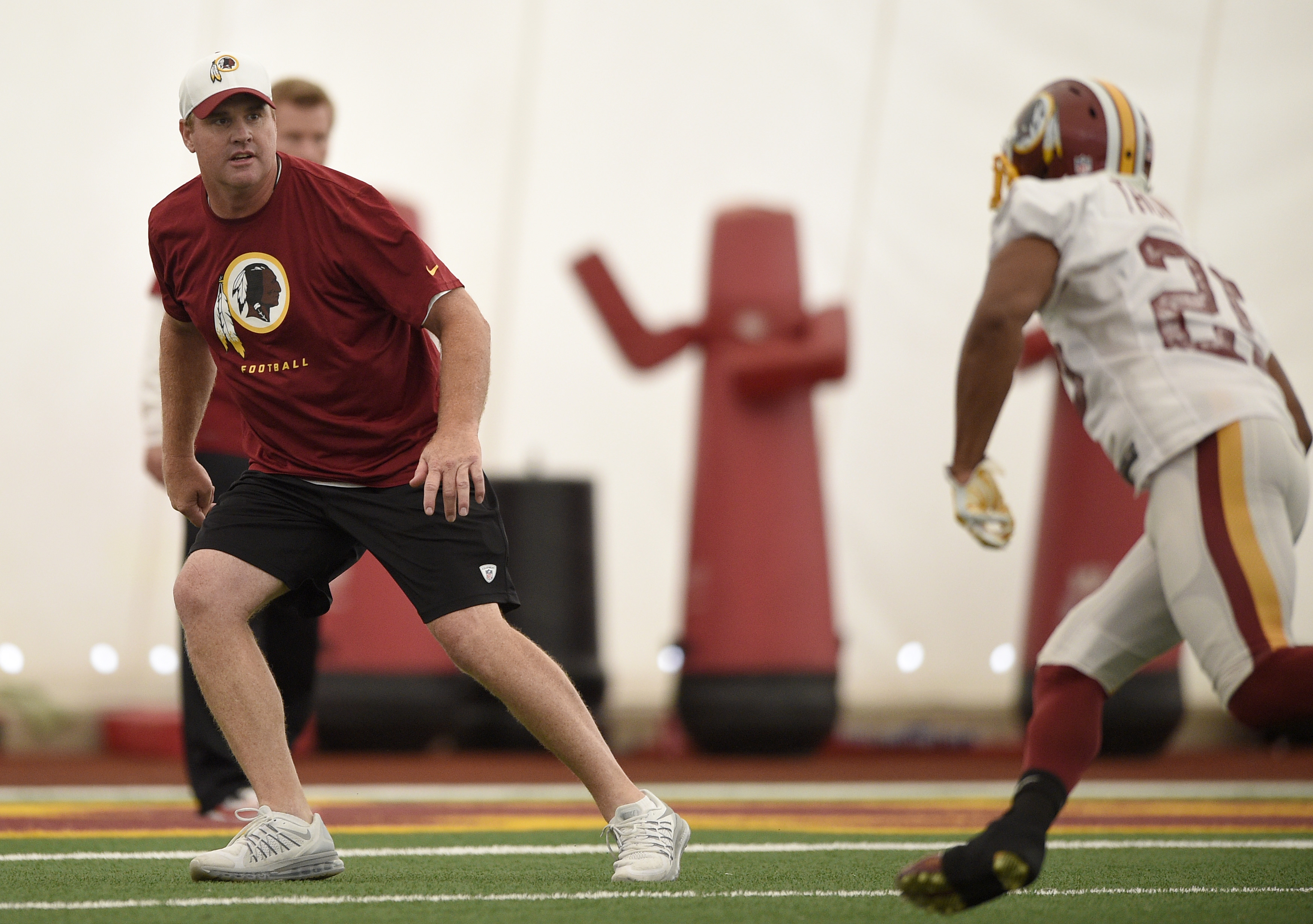 Washington Redskins head coach Jay Gruden, left, drills with the team during an NFL football organized team activity, Tuesday, June 9, 2015, in Ashburn, Va. (AP Photo/Nick Wass)