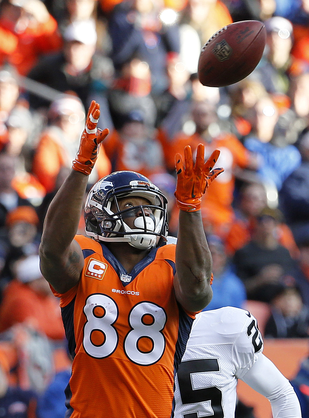 FILE- In this Dec. 28, 2014, file photo, Denver Broncos wide receiver Demaryius Thomas (88) pulls in a pass to set up a touchdown run against the Oakland Raiders during the first half of an NFL football game in Denver. Thomas said Monday, March 30, 2015,