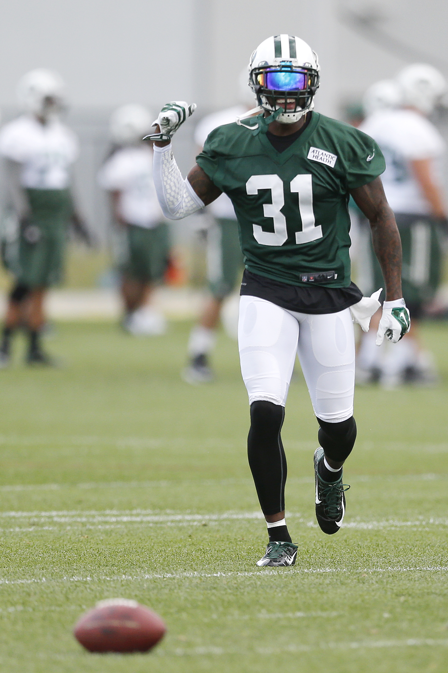 New York Jets cornerback Antonio Cromartie laughs after running a drill during a mandatory minicamp at the NFL football team's facility, Tuesday, June 9, 2015, in Florham Park, N.J. (AP Photo/Julio Cortez)