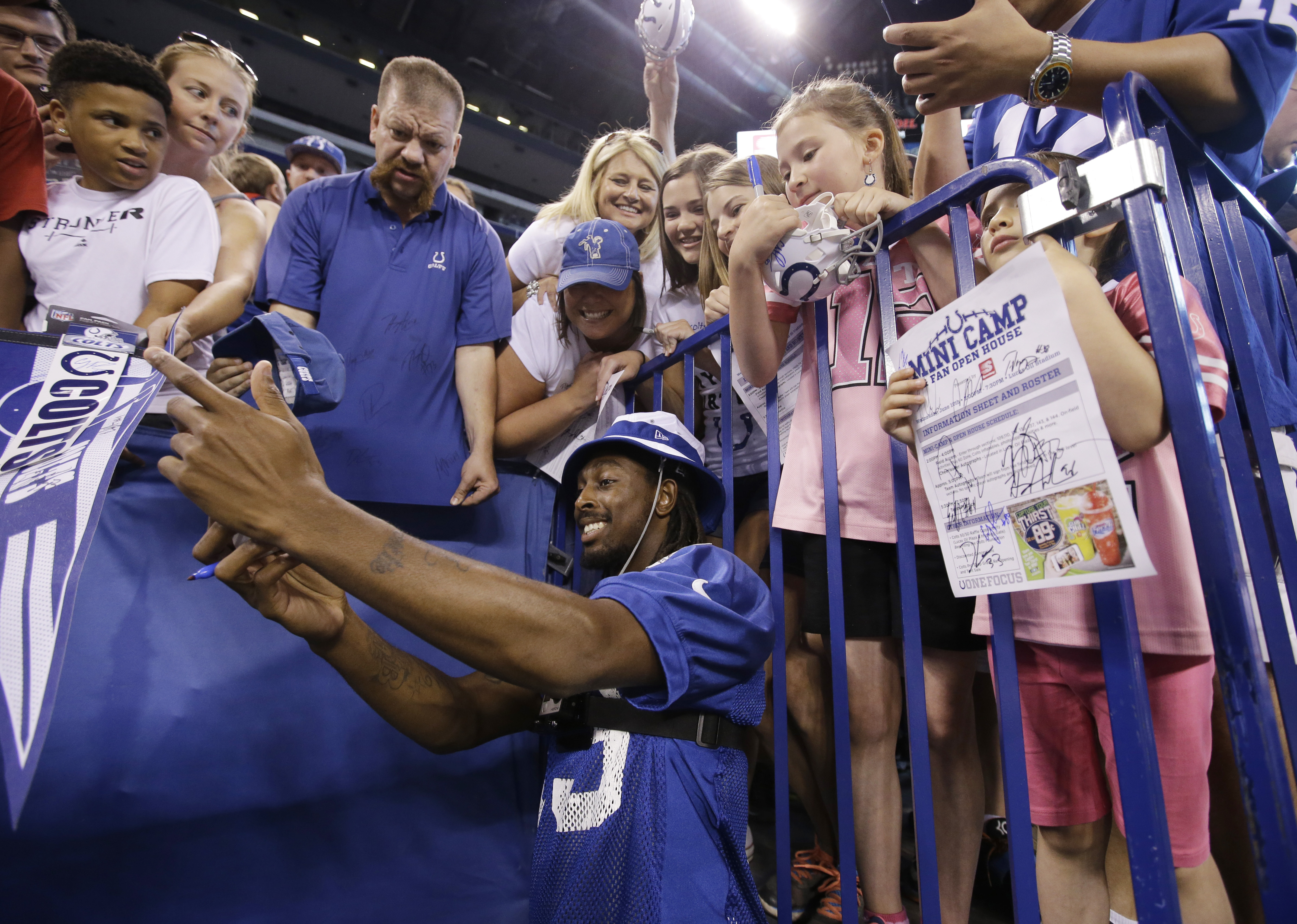 Indianapolis Colts' T.Y. Hilton takes a photo of himself with fans phone before an NFL football organized team activity at Lucas Oil Stadium Wednesday, June 10, 2015, in Indianapolis. (AP Photo/Darron Cummings)