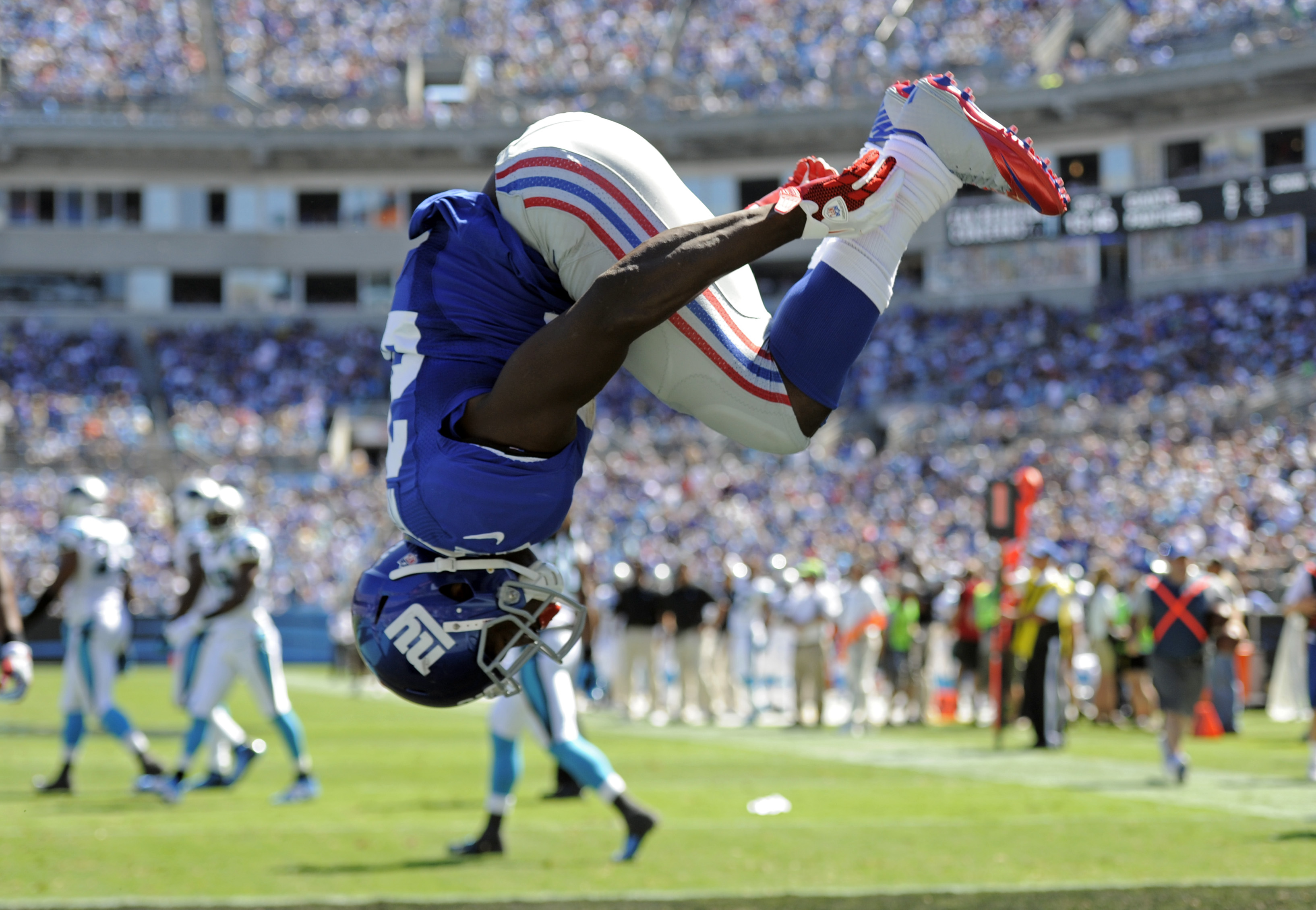 FILE - In this Sept. 22, 2013, file photo, New York Giants' David Wilson does a flip after thinking he had scored a touchdown against the Carolina Panthers during the first half of an NFL football game in Charlotte, N.C. The run was called back for a pena