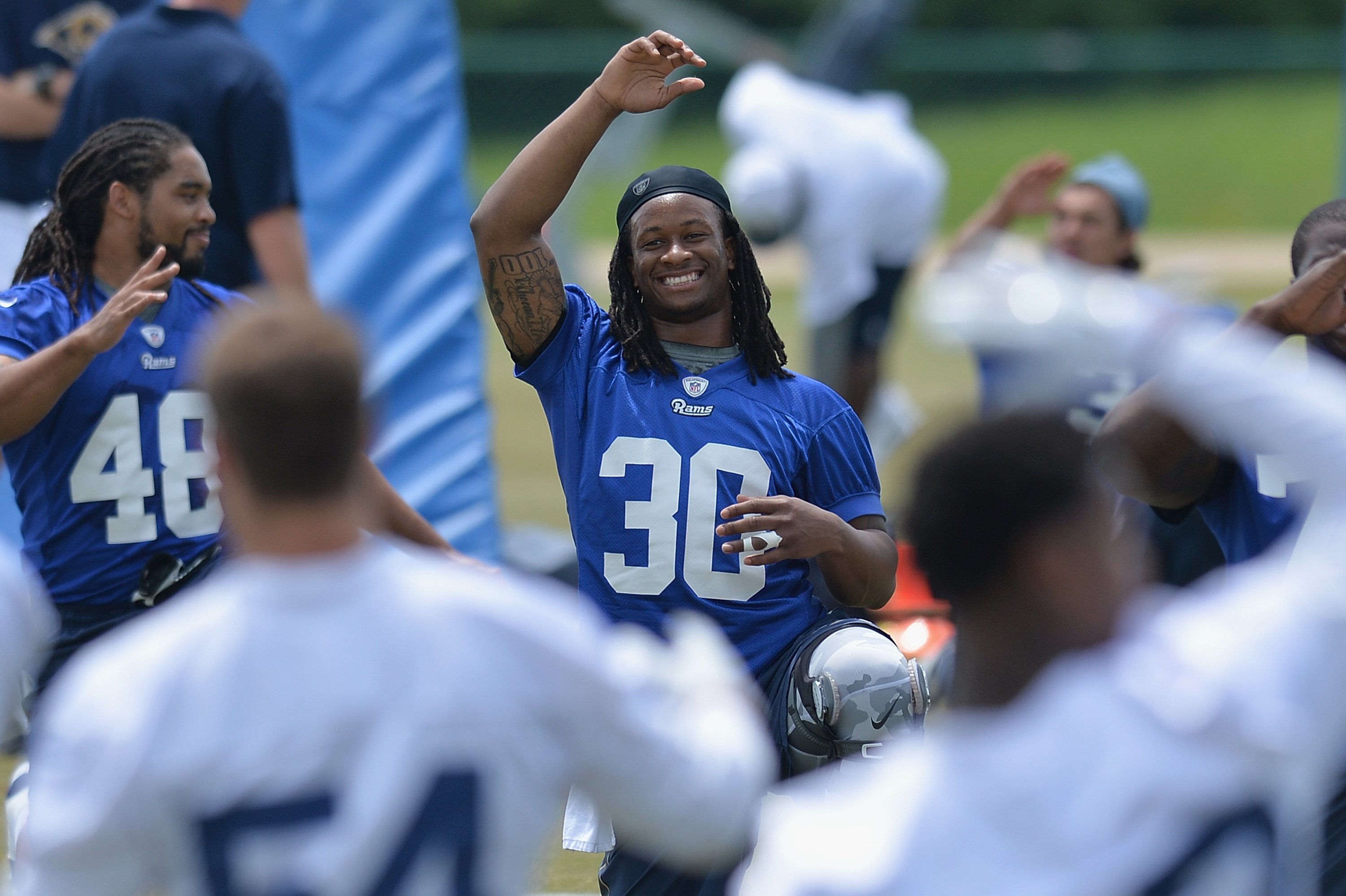 St. Louis Rams rookie running back Todd Gurley (30) stretches during an NFL football organized team activity, Thursday, June 11, 2015, in St. Louis. (AP Photo/Michael Thomas)