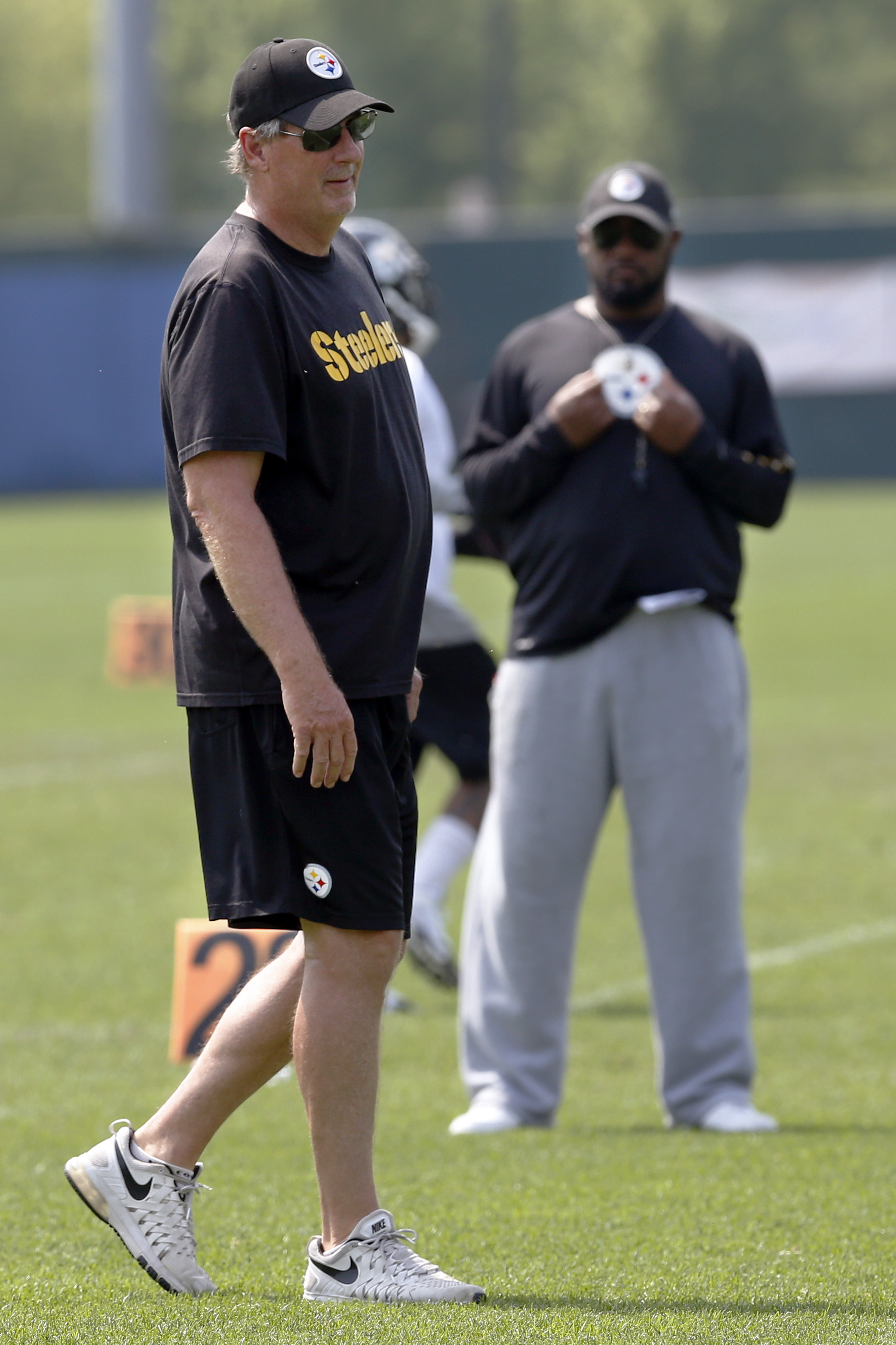 Pittsburgh Steelers defensive coordinator Keith Butler, left, walks past head coach Mike Tomlin as they watch the team go through drills during an NFL football organized team activity, Thursday, June 11, 2015 in Pittsburgh. Butler, the longtime linebacker