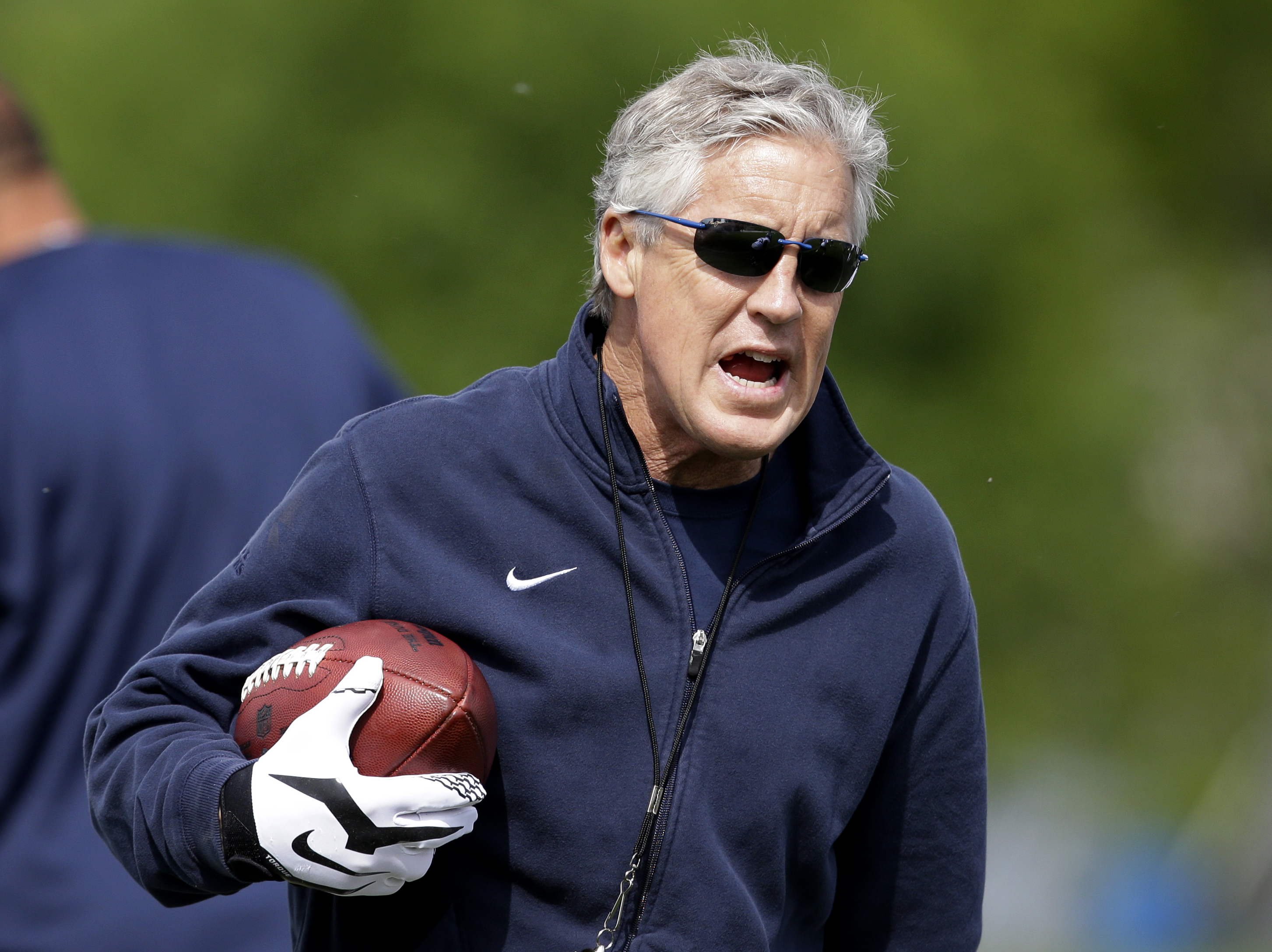 FILE - In this May 10, 2015, file photo, Seattle Seahawks head coach Pete Carroll walks on the field during an NFL football rookie minicamp in Renton, Wash. Last offseason, the Seahawks went a little too hard in practice. And they're about to pay for it d