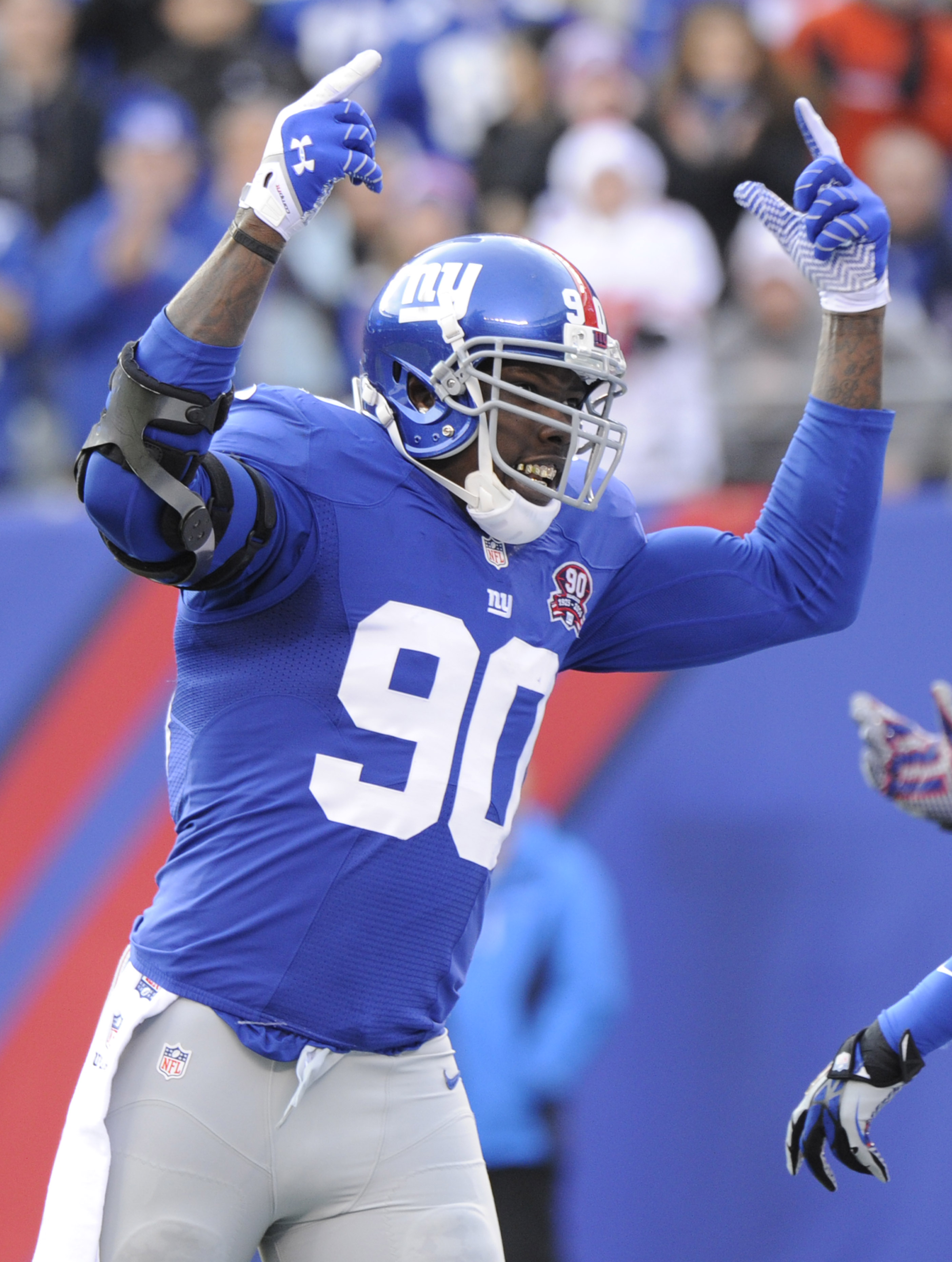 New York Giants' Jason Pierre-Paul reacts during the first half of an NFL football game against the Philadelphia Eagles Sunday, Dec. 28, 2014, in East Rutherford, N.J. (AP Photo/Bill Kostroun)