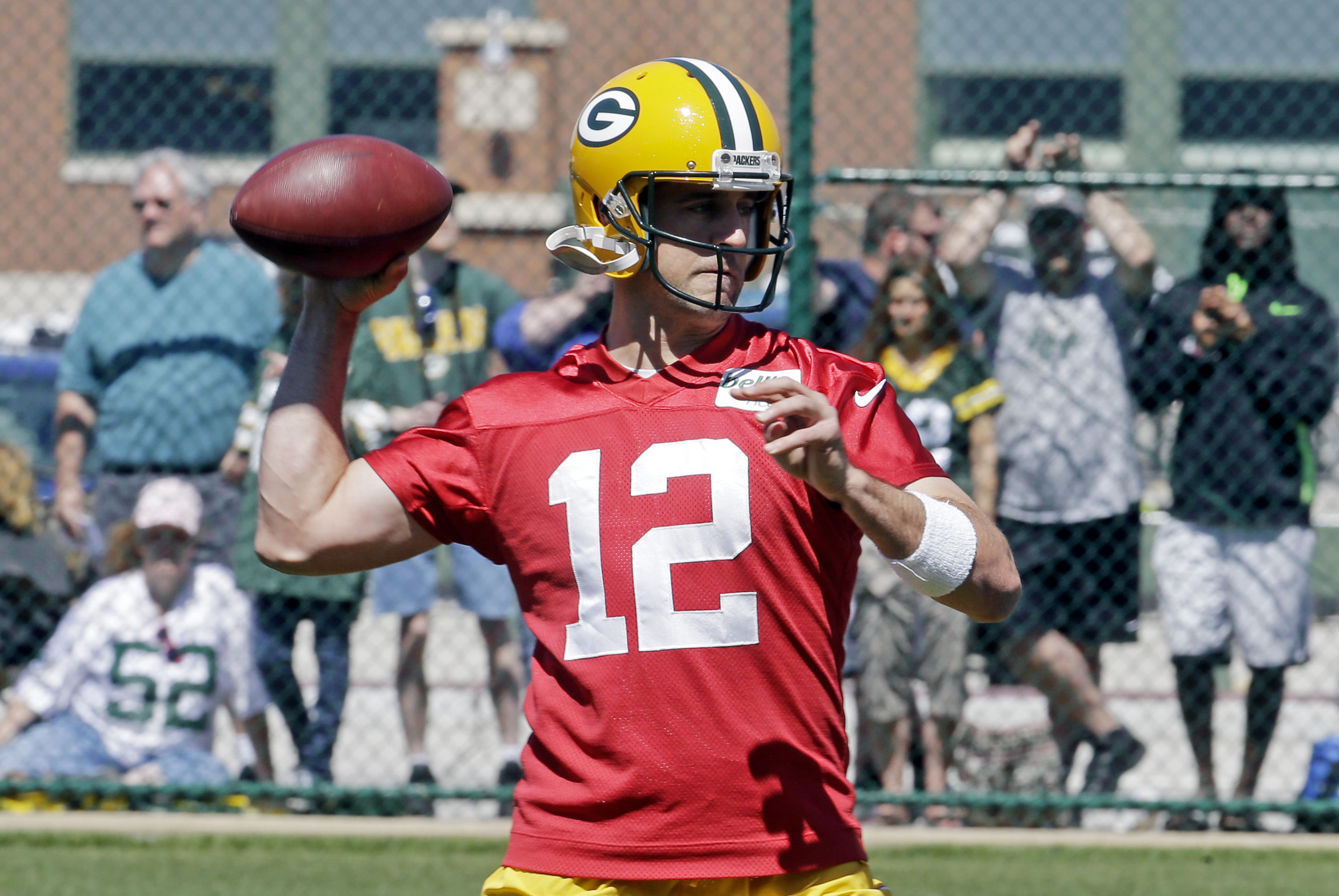 Green Bay Packers' Aaron Rodgers throws a pass during NFL football minicamp, Tuesday, June 16, 2015, in Green Bay, Wis. (AP Photo/Morry Gash)