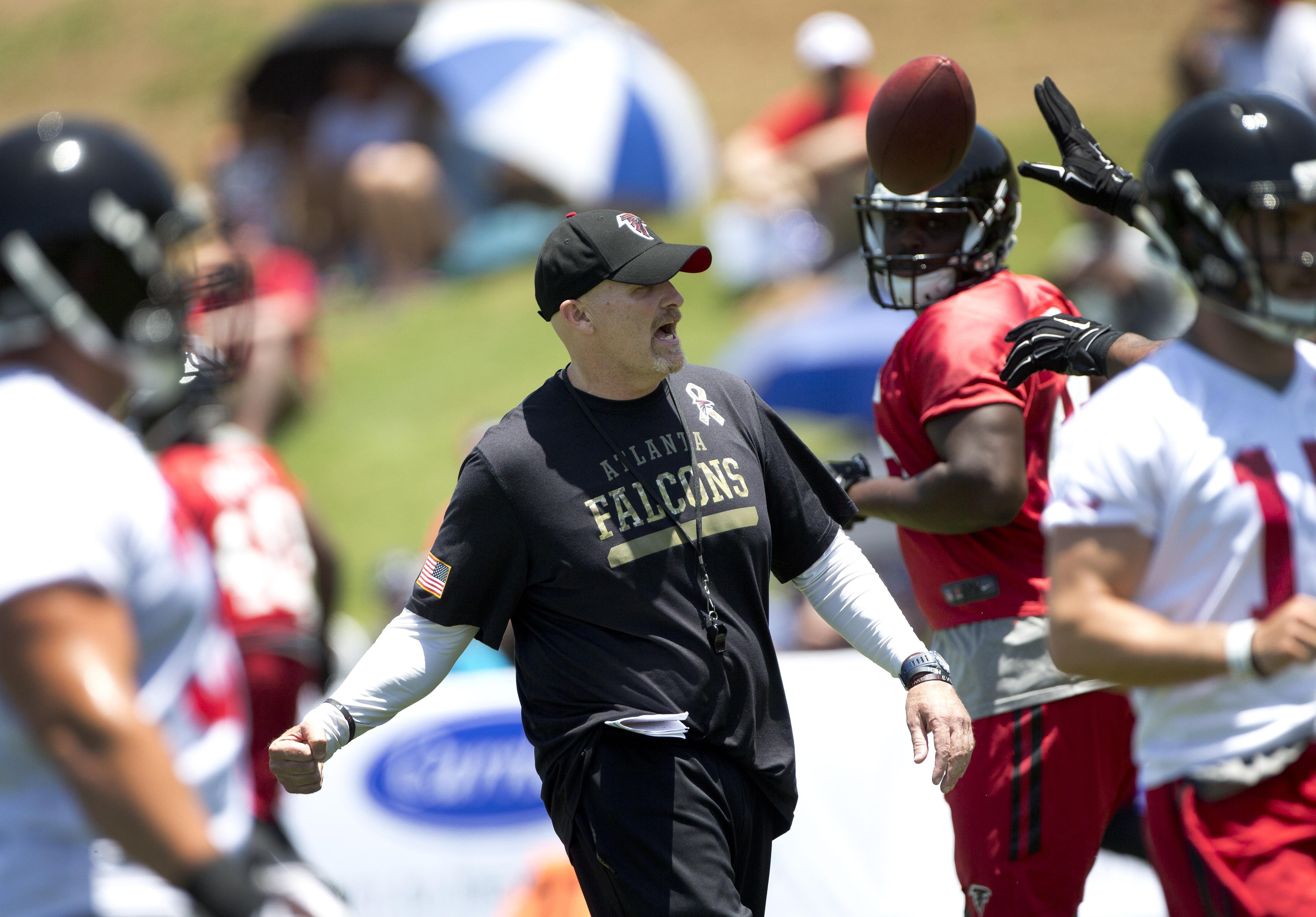 Atlanta Falcons head coach Dan Quinn directs his players during NFL football minicamp, Tuesday, June 16, 2015, in Flowery Branch, Ga. (AP Photo/John Bazemore)