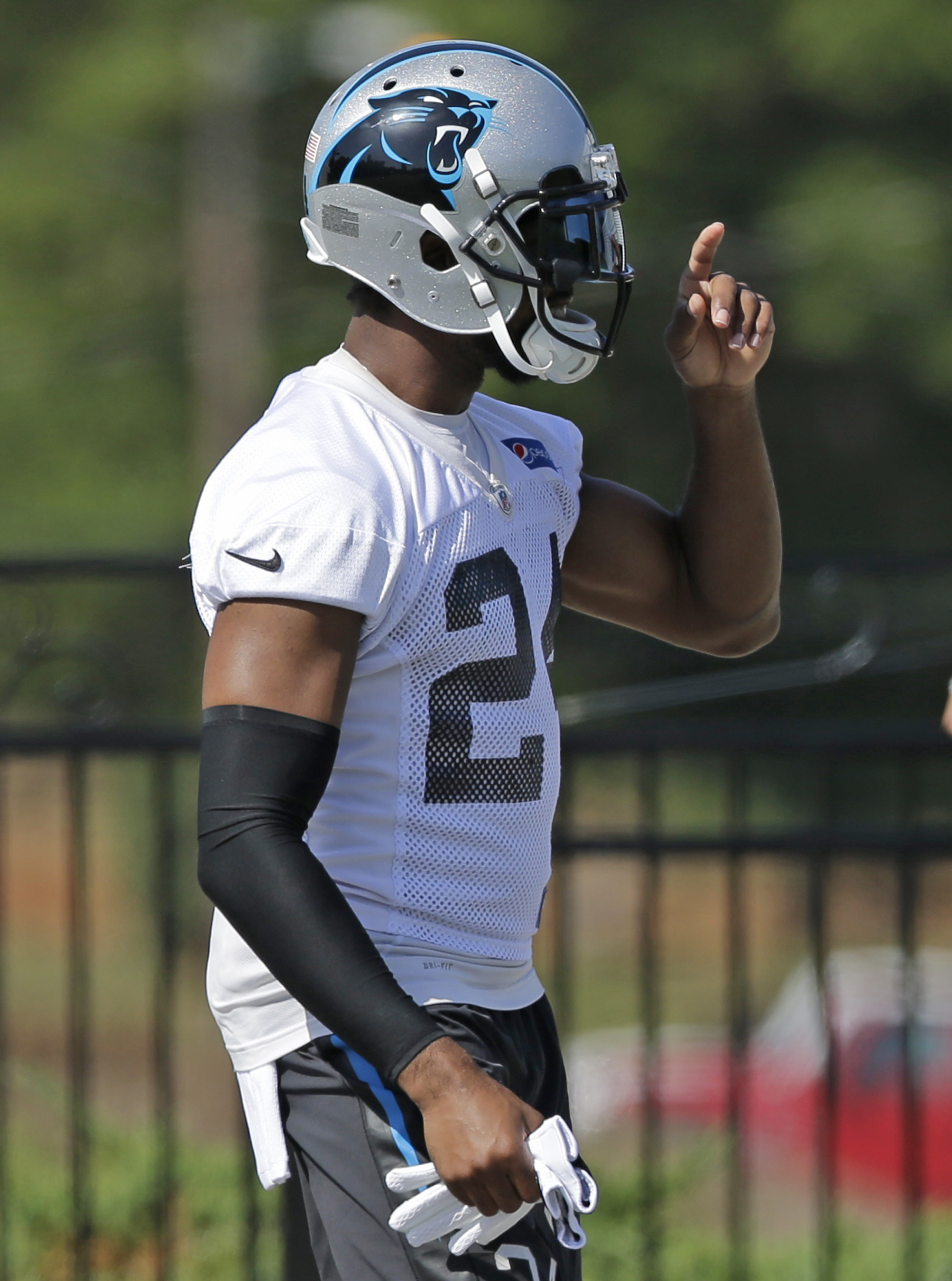 Carolina Panthers' Josh Norman waves to teammates as he arrives for the NFL football minicamp in Charlotte, N.C., Tuesday, June 16, 2015. Norman is on the verge of emerging as one of the best cornerbacks in the NFL, according to Panthers assistant head co
